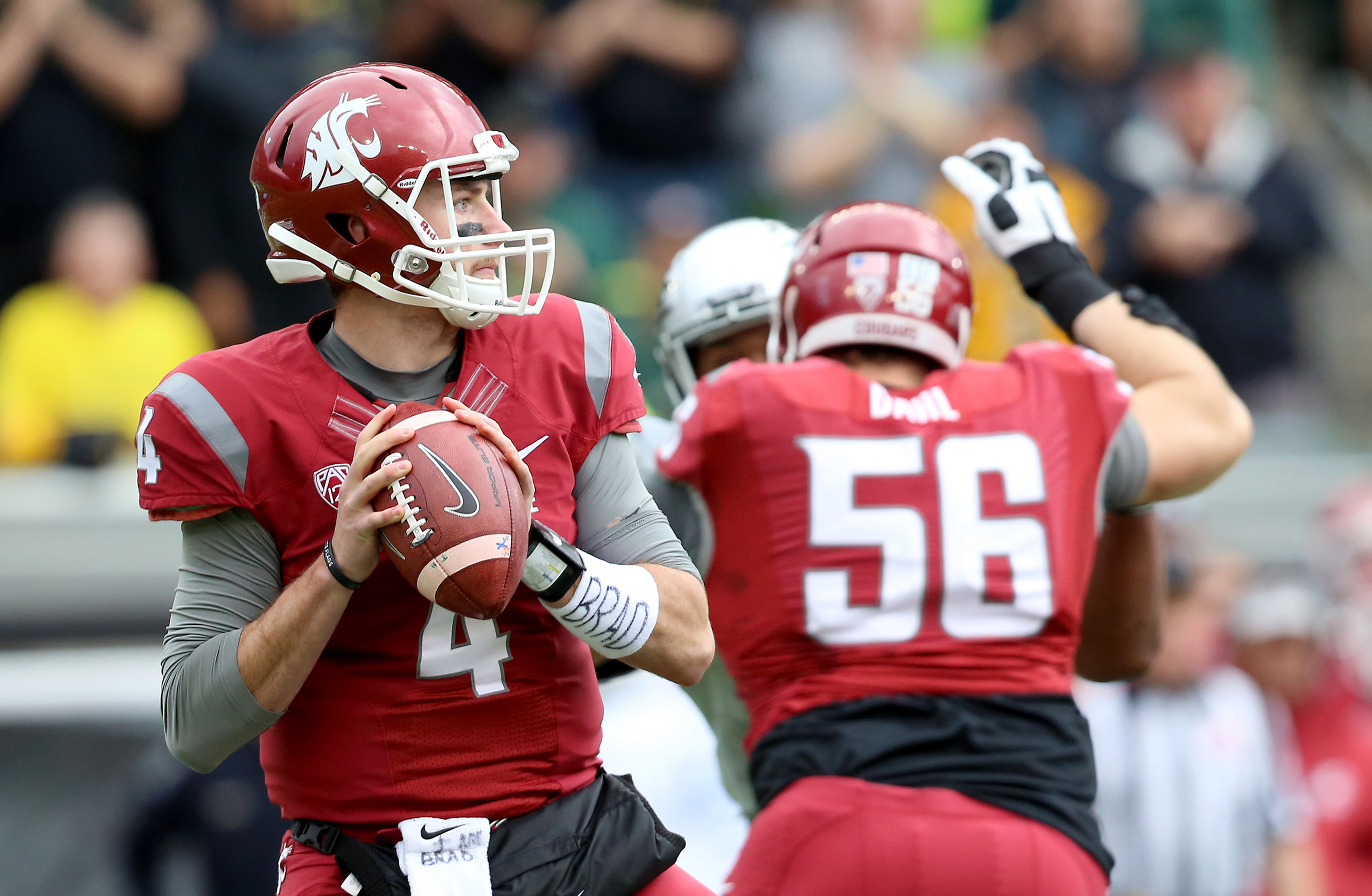 FILE - In this Oct. 10, 2015, file photo, Washington State quarterback Luke Falk (4) looks to throw during the first half of an NCAA college football game against Oregon in Eugene, Ore. Luke Falk is the latest Air Raid quarterback to benefit from Wazzu's
