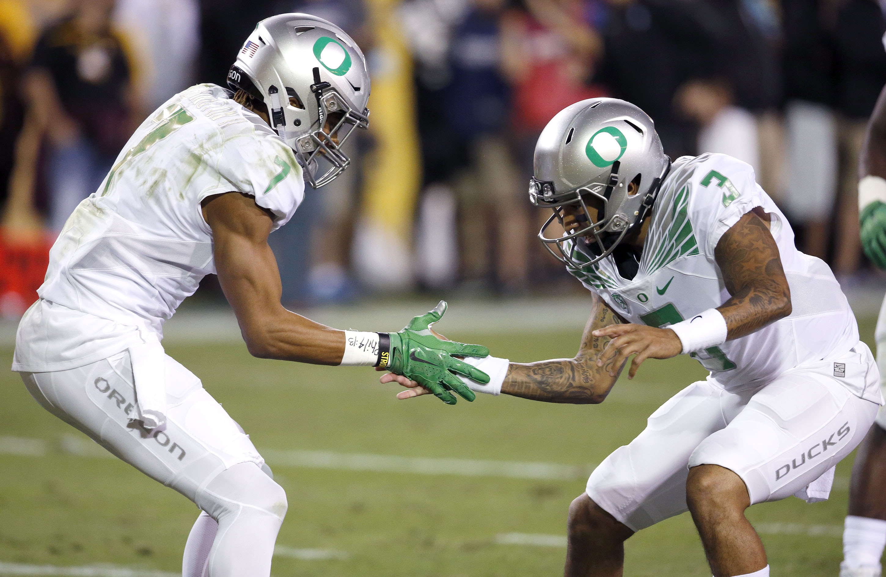Oregon's Darren Carrington (7) celebrates his touchdown catch against Arizona State with quarterback Vernon Adams Jr. (3) during the first half of an NCAA college football game Thursday, Oct. 29, 2015, in Tempe, Ariz. (AP Photo/Ross D. Franklin)