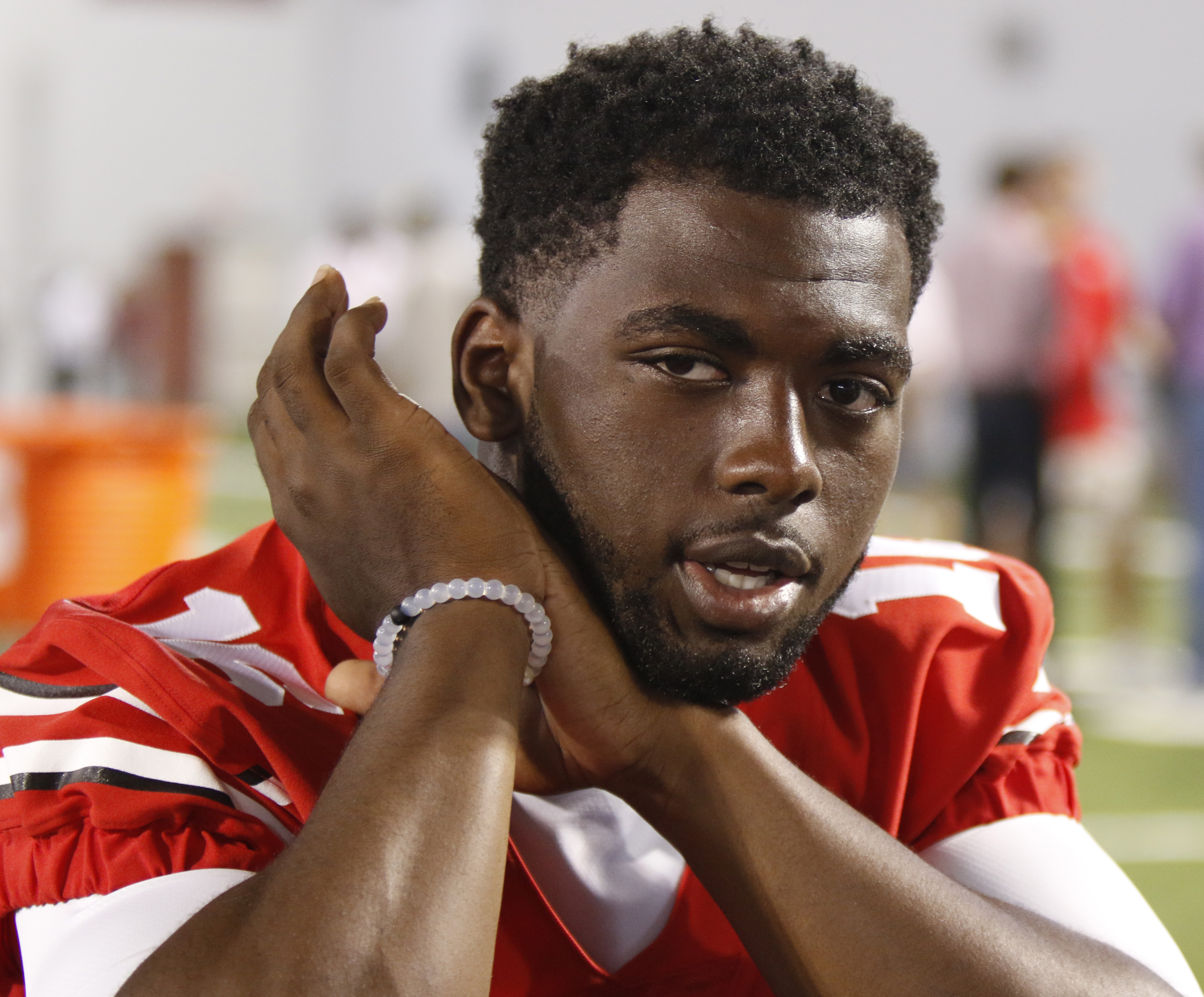 IFLE - In this Aug. 16, 2015, file photo, Ohio State quarterback J.T. Barrett speaks to reporters during the university's NCAA college football media day in Columbus, Ohio. Ohio State quarterback J.T. Barrett has been suspended for one game after being ci
