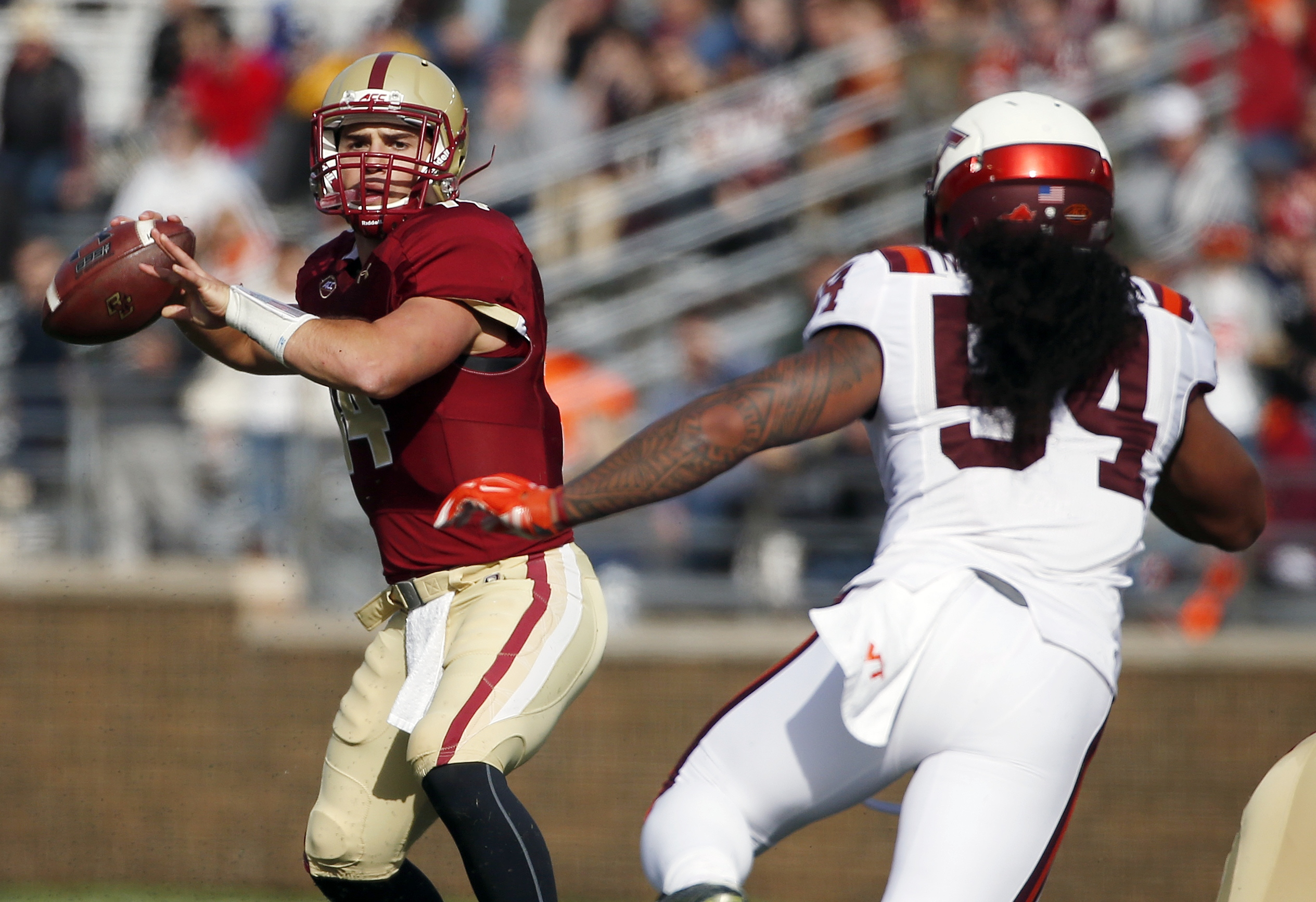 Boston College quarterback John Fadule (14) looks to pass under pressure from Virginia Tech linebacker Andrew Motuapuaka (54) during the second quarter of an NCAA college football game in Boston, Saturday, Oct. 31, 2015. (AP Photo/Michael Dwyer)