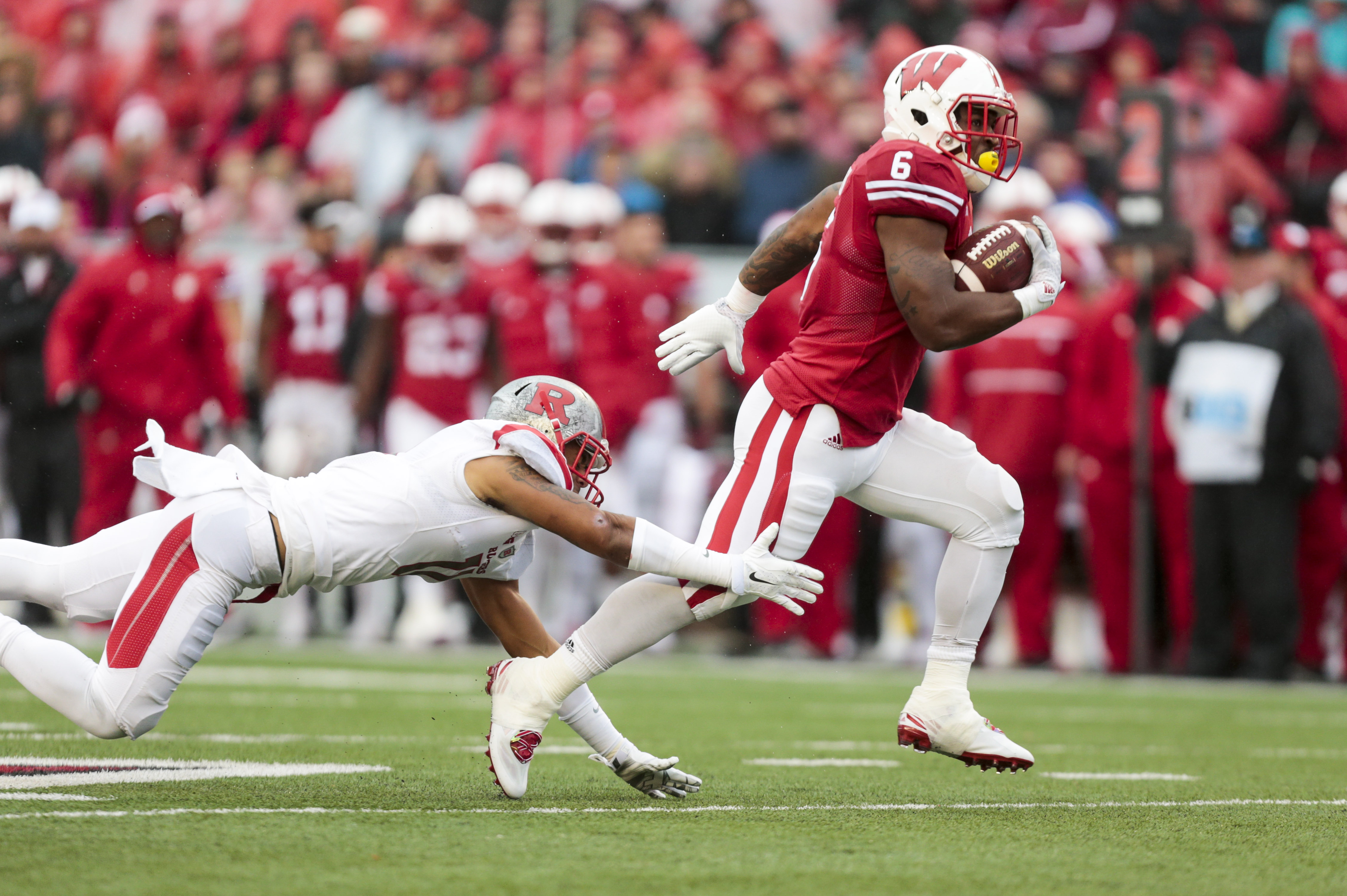 Wisconsin running back Corey Clement (6) runs for a first down past Rutgers defensive back Isaiah Wharton (11) during the second half of an NCAA college football game, Saturday, Oct. 31, 2015, in Madison, Wis. Wisconsin 48-10. (AP Photo/Andy Manis)