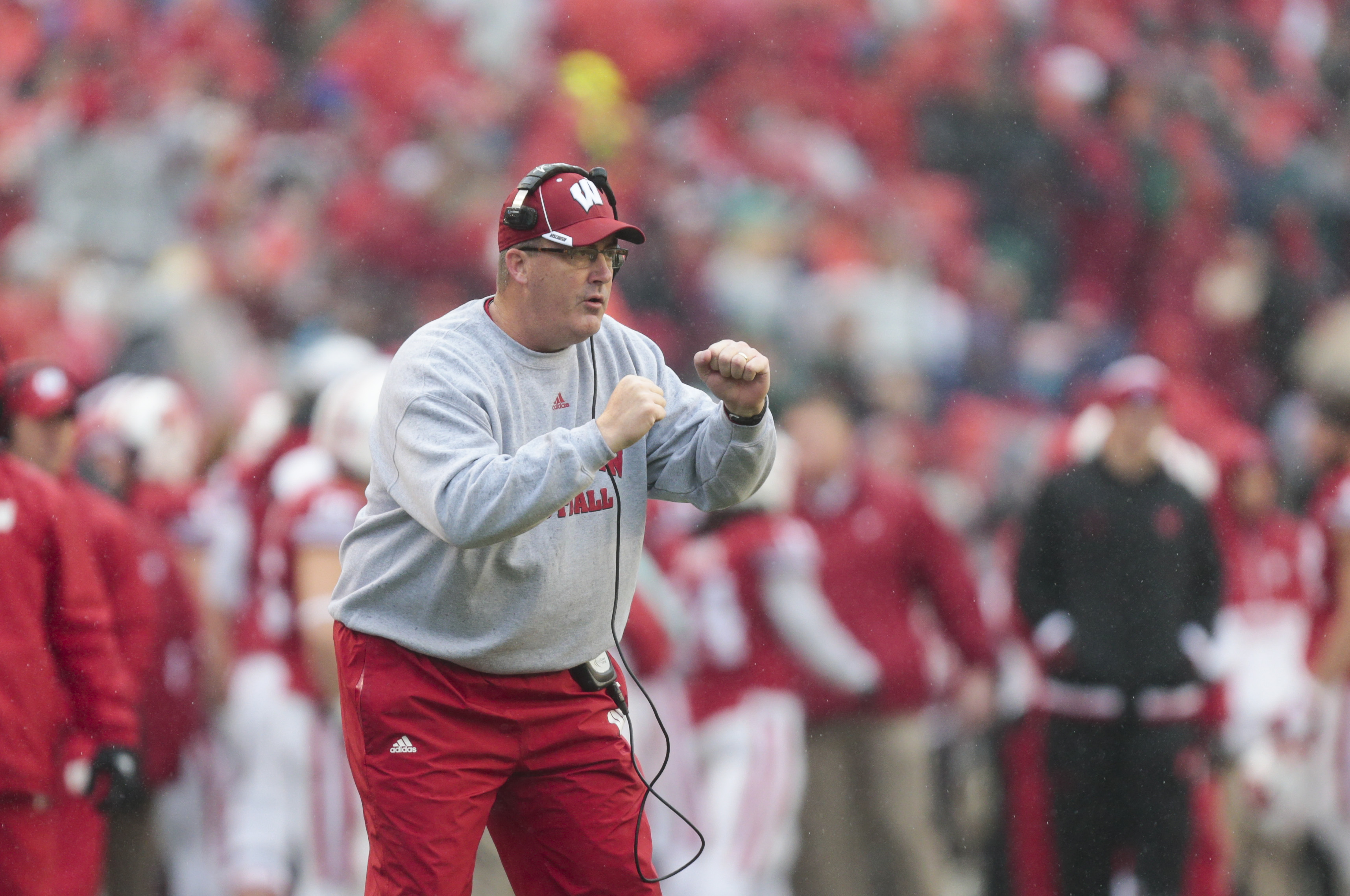 Wisconsin coach Paul Chryst cheers on his team during the first half of an NCAA college football game against Rutgers, Saturday, Oct. 31, 2015, in Madison, Wis. Wisconsin won 48-10. (AP Photo/Andy Manis)