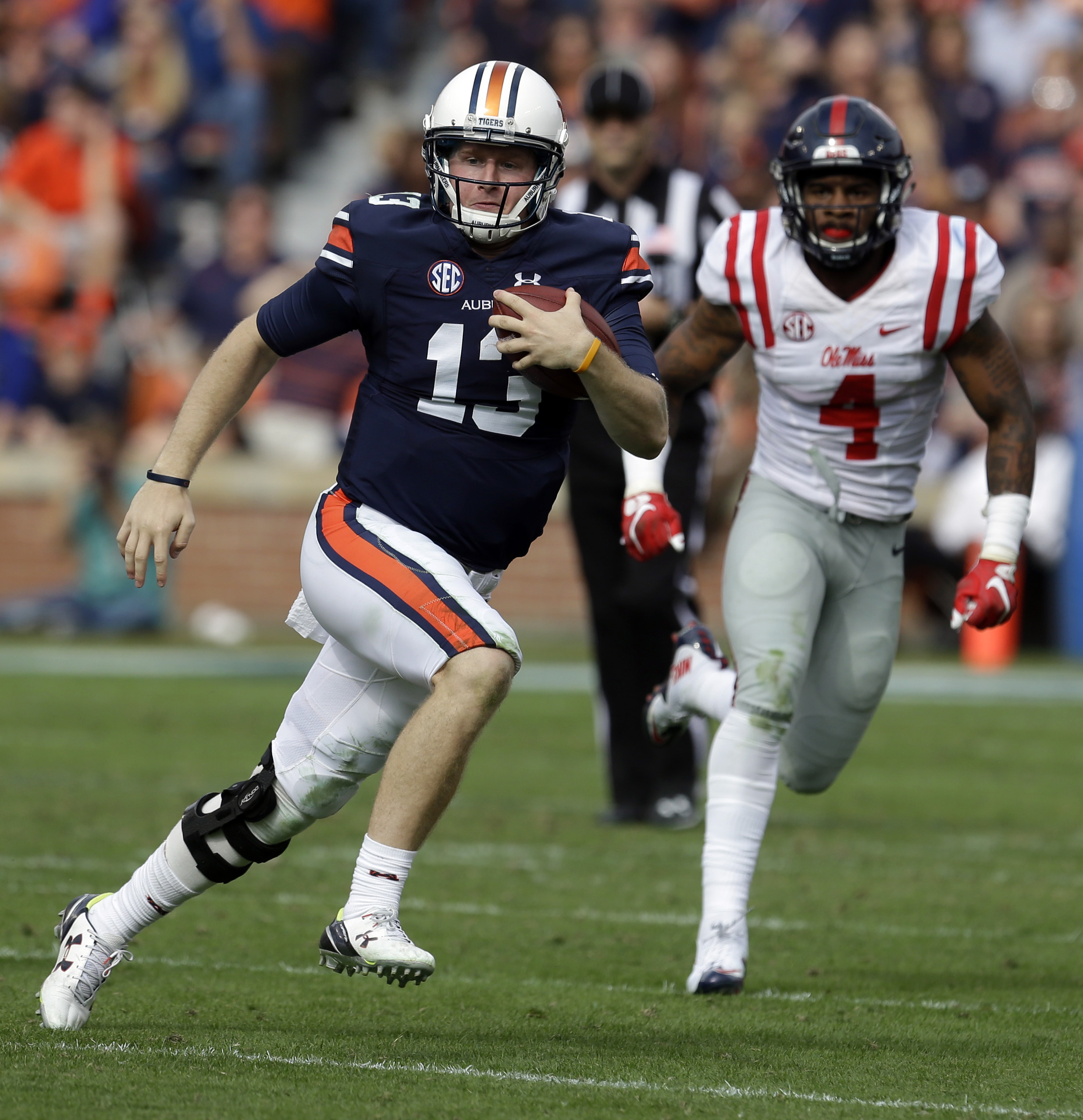Auburn quarterback Sean White (13) scrambles for yardage during the second half of an NCAA college football game against Mississippi, Saturday, Oct. 31, 2015, in Auburn, Ala. Mississippi defeated Auburn 27-19. (AP Photo/Butch Dill)