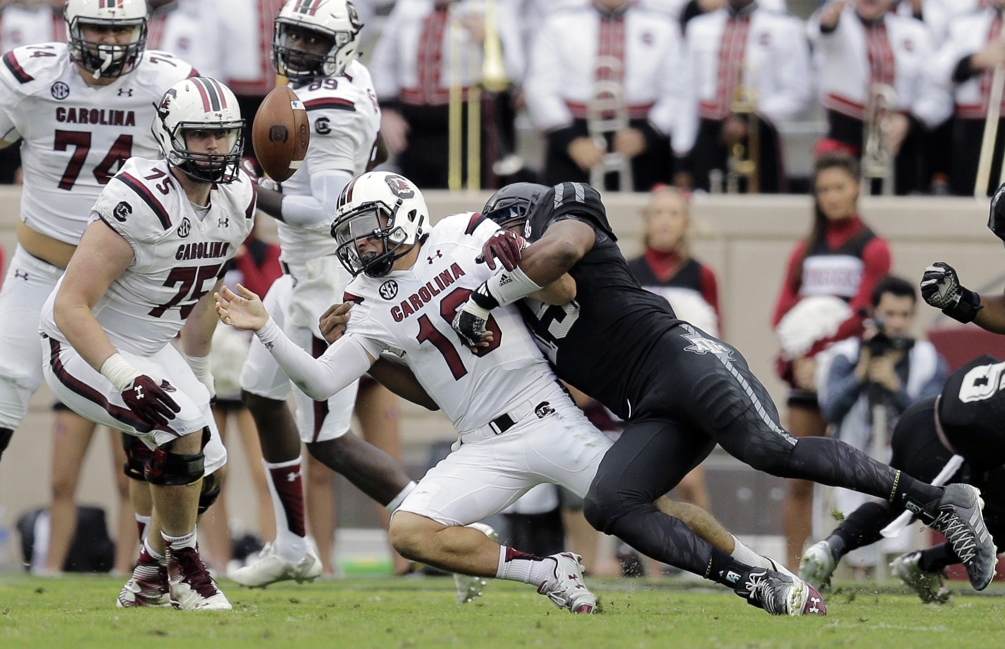 South Carolina quarterback Perry Orth (10) loses the ball as he is hit by Texas A&M defensive lineman Myles Garrett, right, during the second half of an NCAA college football game, Saturday, Oct. 31, 2015, in College Station, Texas. Texas A&M won 35-28. (