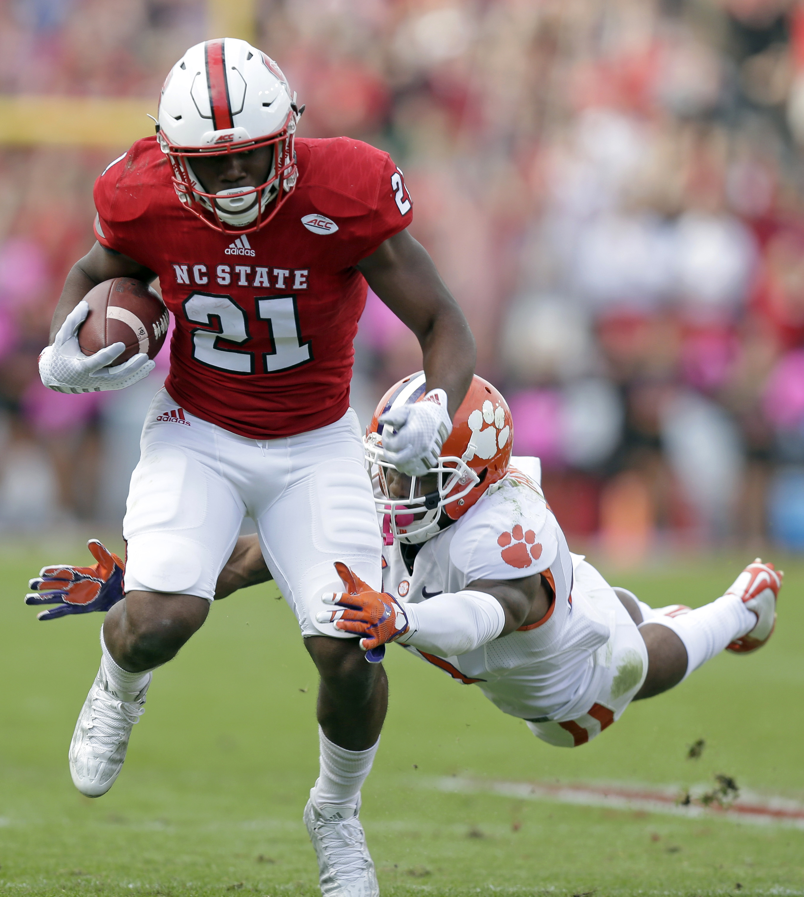 Clemson's Cordrea Tankersley, right. dives for North Carolina State's Matthew Dayes (21) during the first half of an NCAA college football game in Raleigh, N.C., Saturday, Oct. 31, 2015. (AP Photo/Gerry Broome)