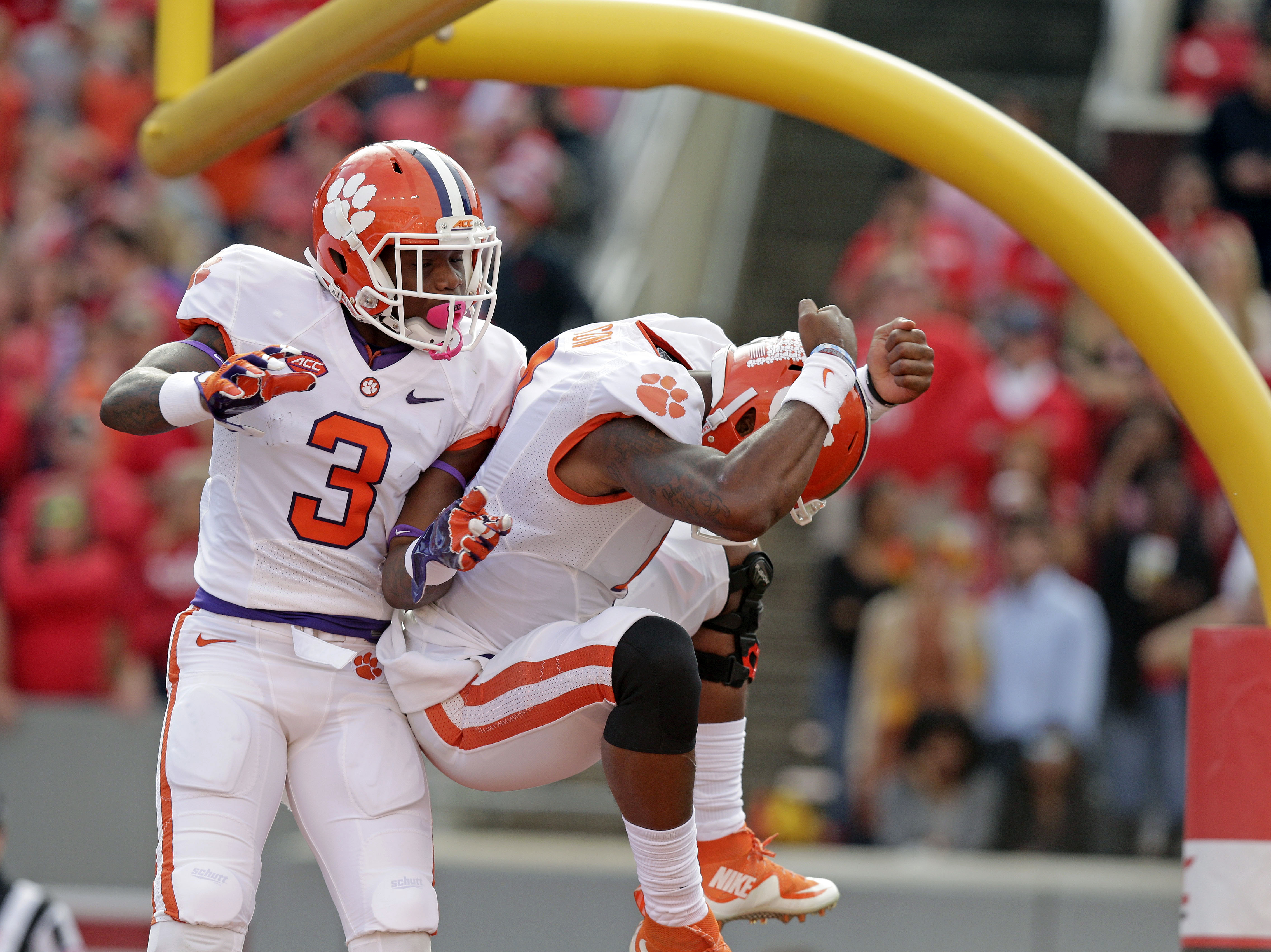 Clemson's Artavis Scott (3) and quarterback Deshaun Watson celebrate Watson's touchdown against North Carolina State during the first half of an NCAA college football game in Raleigh, N.C., Saturday, Oct. 31, 2015. Clemson won 56-41. (AP Photo/Gerry Broom