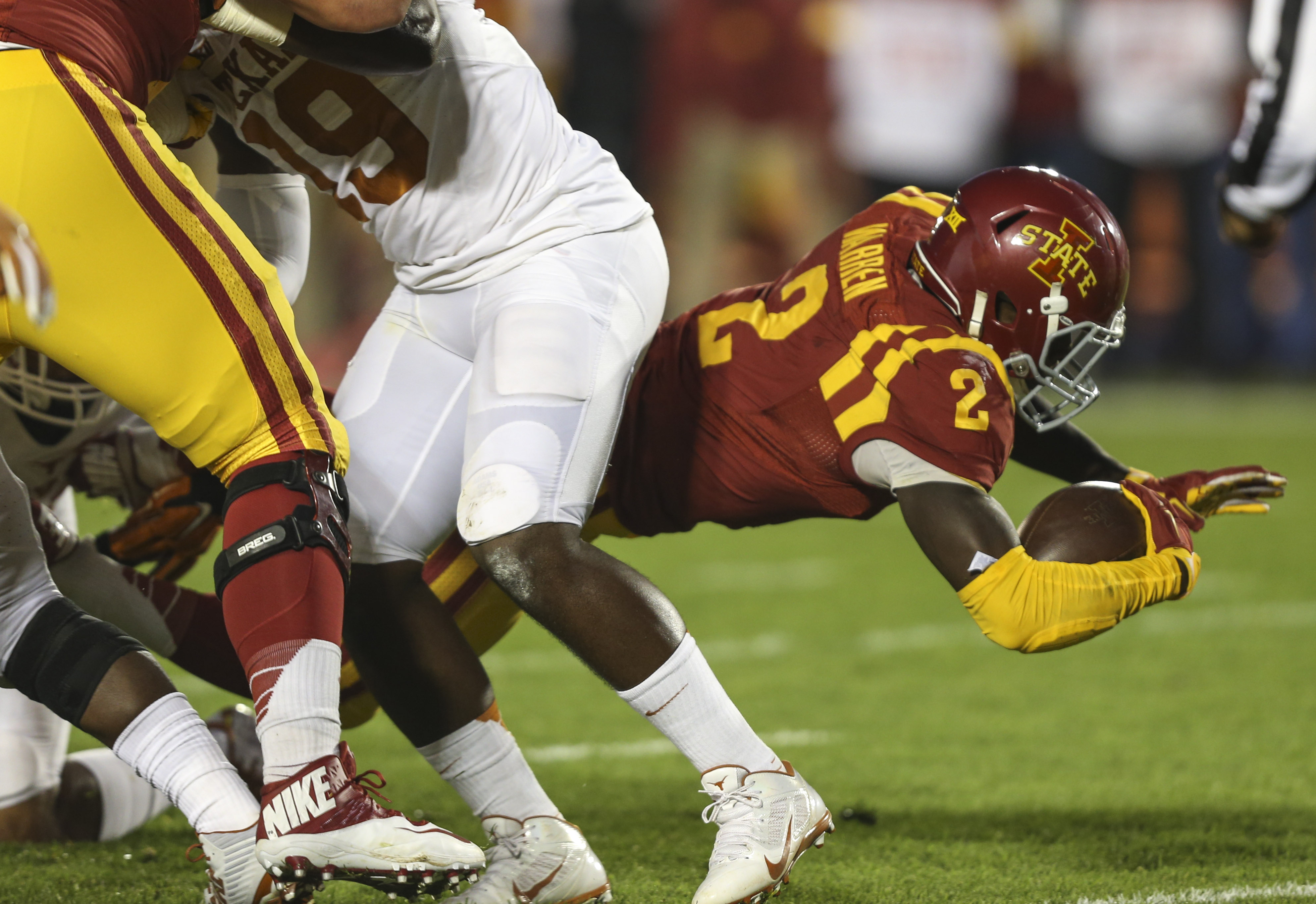 Iowa State running back Mike Warren dives into the end zone for a touchdown during the first half of an NCAA college football game against Texas, Saturday, Oct. 31, 2015, in Ames, Iowa. (AP Photo/Justin Hayworth)