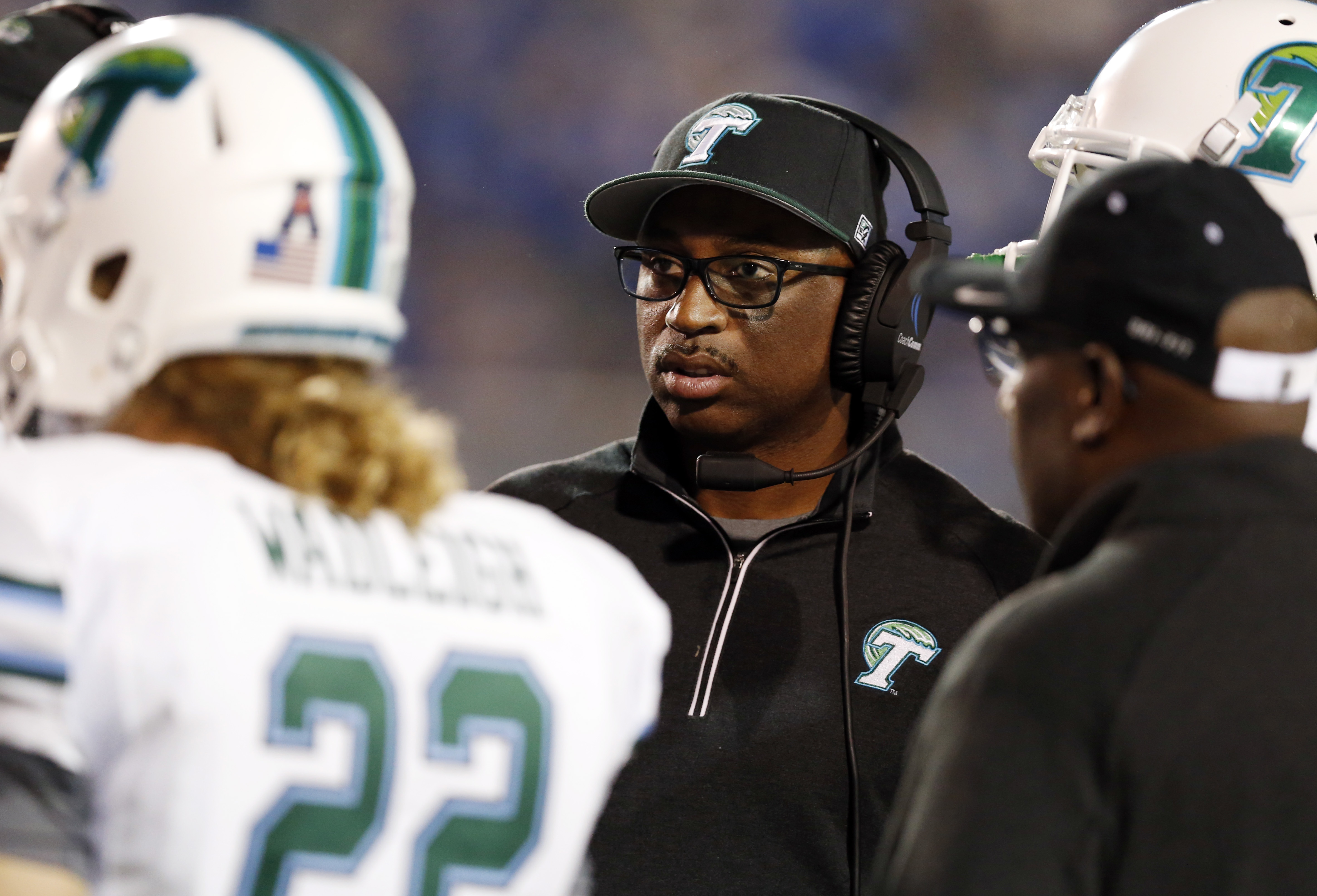 Tulane head coach Curtis Johnson watches after his players during a time out in the first half of an NCAA college football game against Memphis in Memphis, Tenn., Saturday, Oct. 31, 2015. (AP Photo/Rogelio V. Solis)