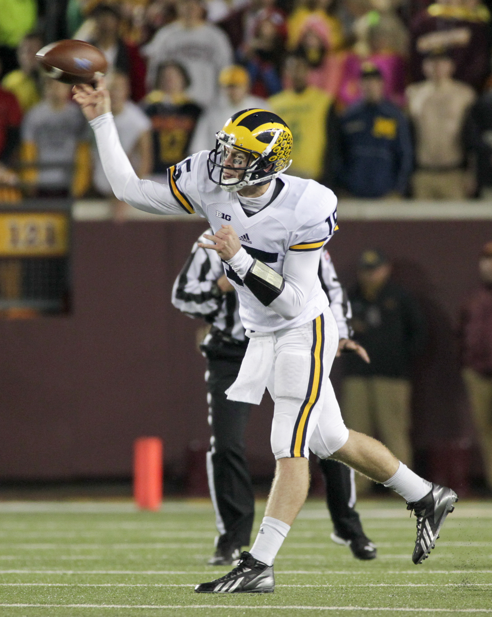 Michigan quarterback Jake Rudock (15) looks to pass during the first half of an NCAA college football game Saturday against Minnesota, Nov. 31, 2015, in Minneapolis.(AP Photo/Paul Battaglia)
