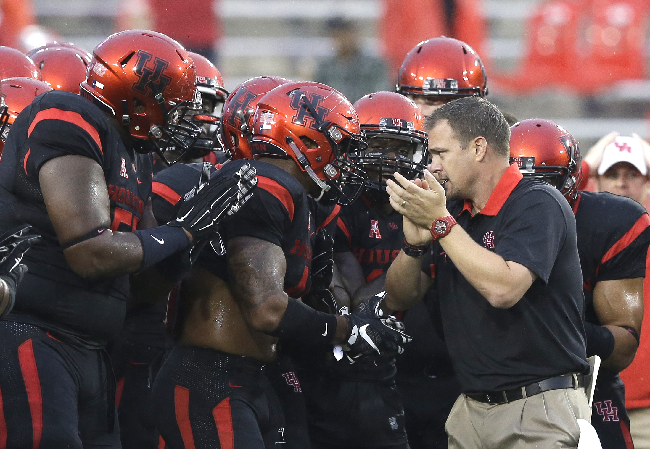 Houston head coach Tom Herman, right revs up his players before the first half of an NCAA college football game against the Vanderbilt Saturday, Oct. 31, 2015, in Houston. Houston won 34-0. (AP Photo/Pat Sullivan)