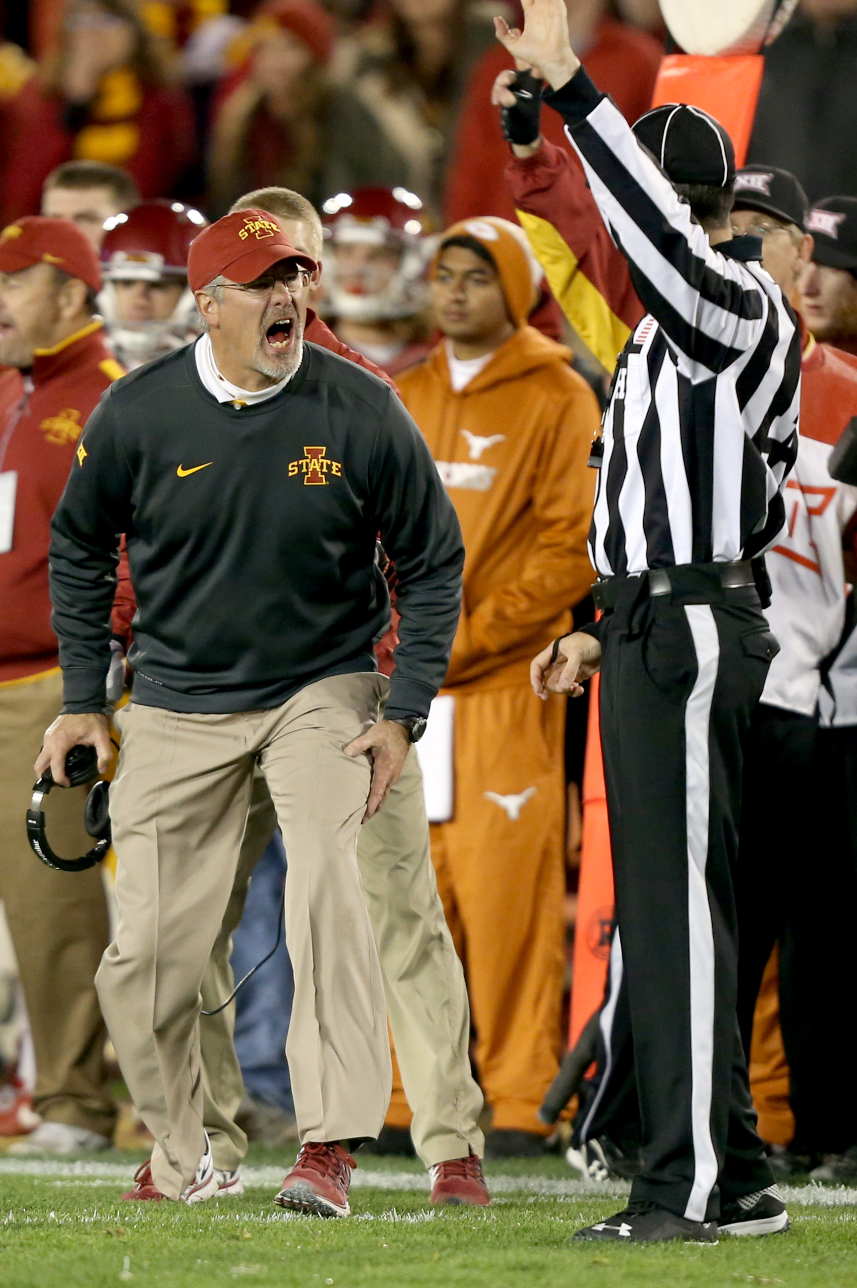 Iowa State head coach Paul Rhoads yells at an official after he thought a penalty should have been called on Texas during the second half of an NCAA college football game, Saturday, Oct. 31, 2015, in Ames, Iowa. Iowa State won 24-0. (AP Photo/Justin Haywo