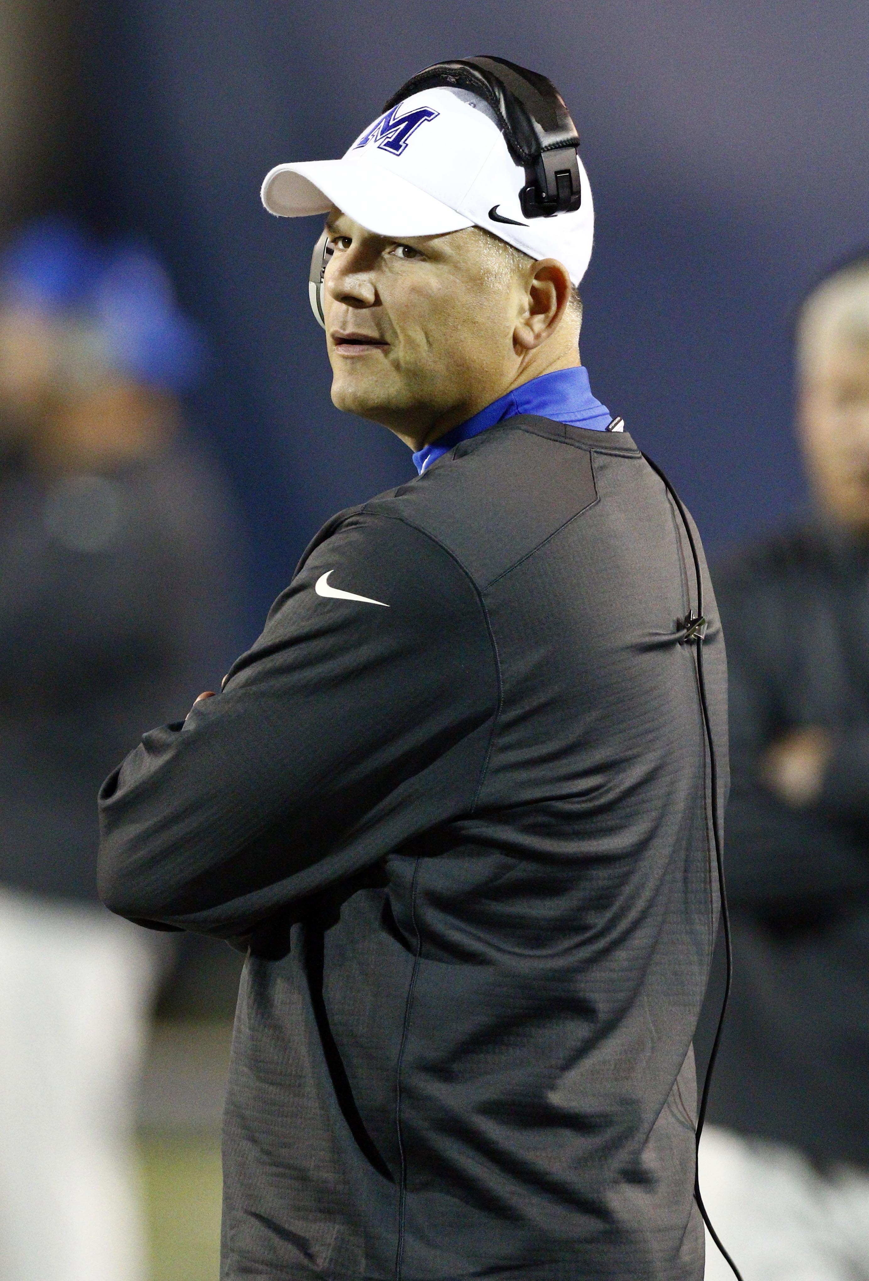 Memphis head coach Justin Fuente looks down field in the second half of an NCAA college football game against Tulane in Memphis, Tenn., Saturday, Oct. 31, 2015. Memphis won 41-13. (AP Photo/Rogelio V. Solis)