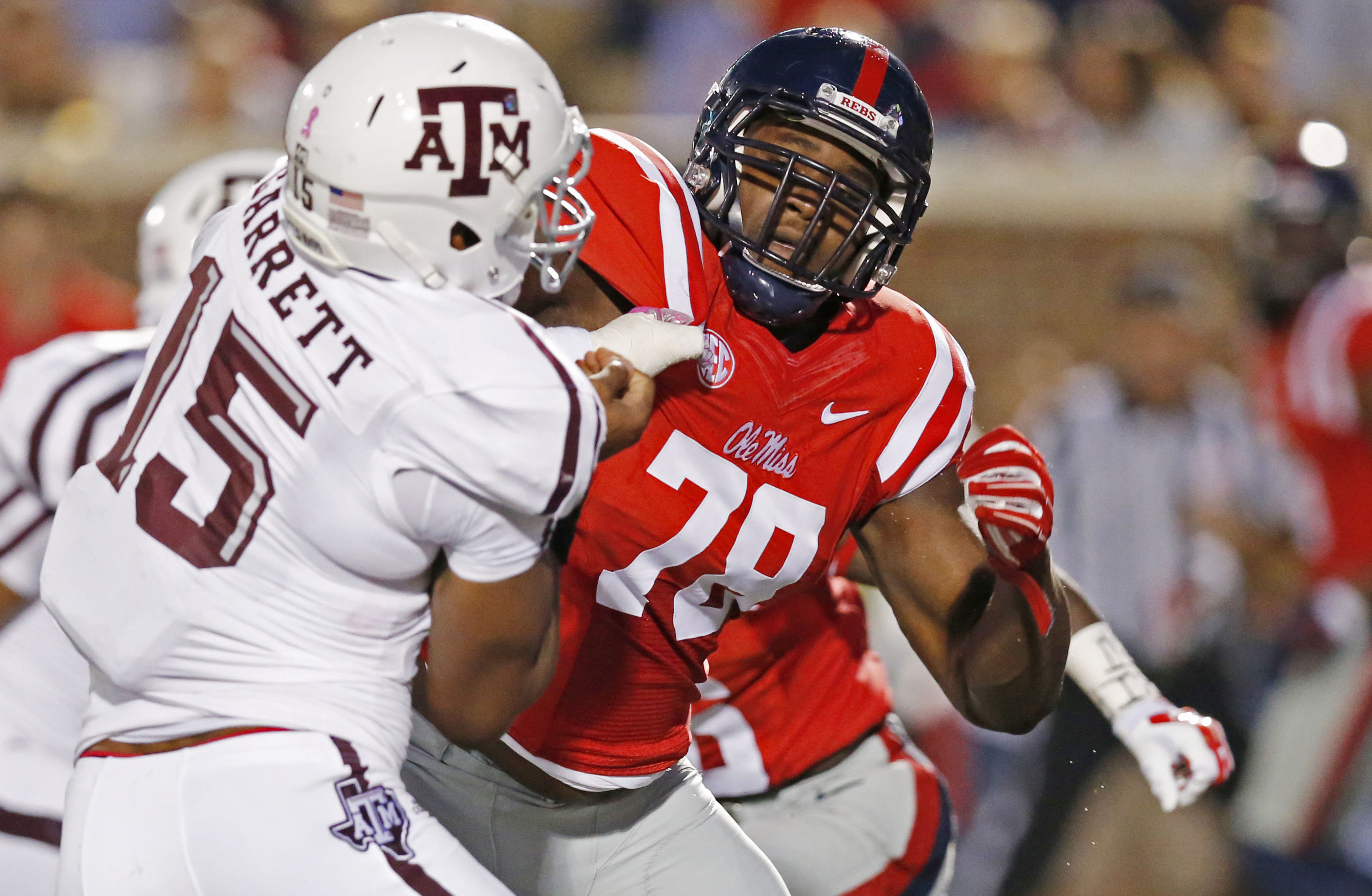 FILE - In this Oct. 24, 2015, file photo, Texas A&M defensive lineman Myles Garrett (15) is locked up by Mississippi offensive lineman Laremy Tunsil (78) during the first half of their NCAA college football game in Oxford, Miss. Some of the Southeastern C