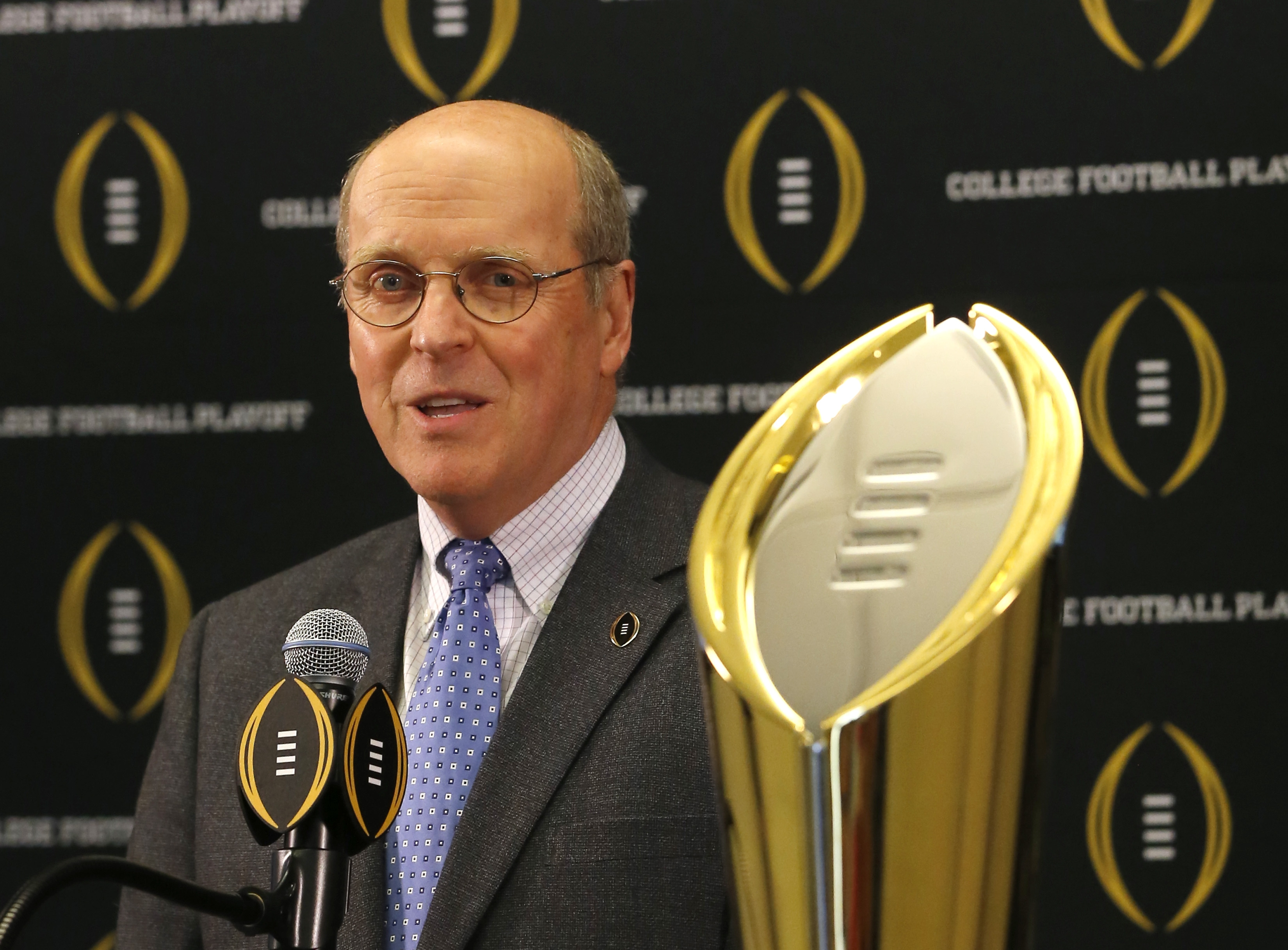 College Football Playoff executive director Bill Hancock announces that Atlanta will host the 2018 national championship game, Santa Clara, Calif., will host the 2019 game, and New Orleans will host the 2020 game, during a news conference Wednesday, Nov.