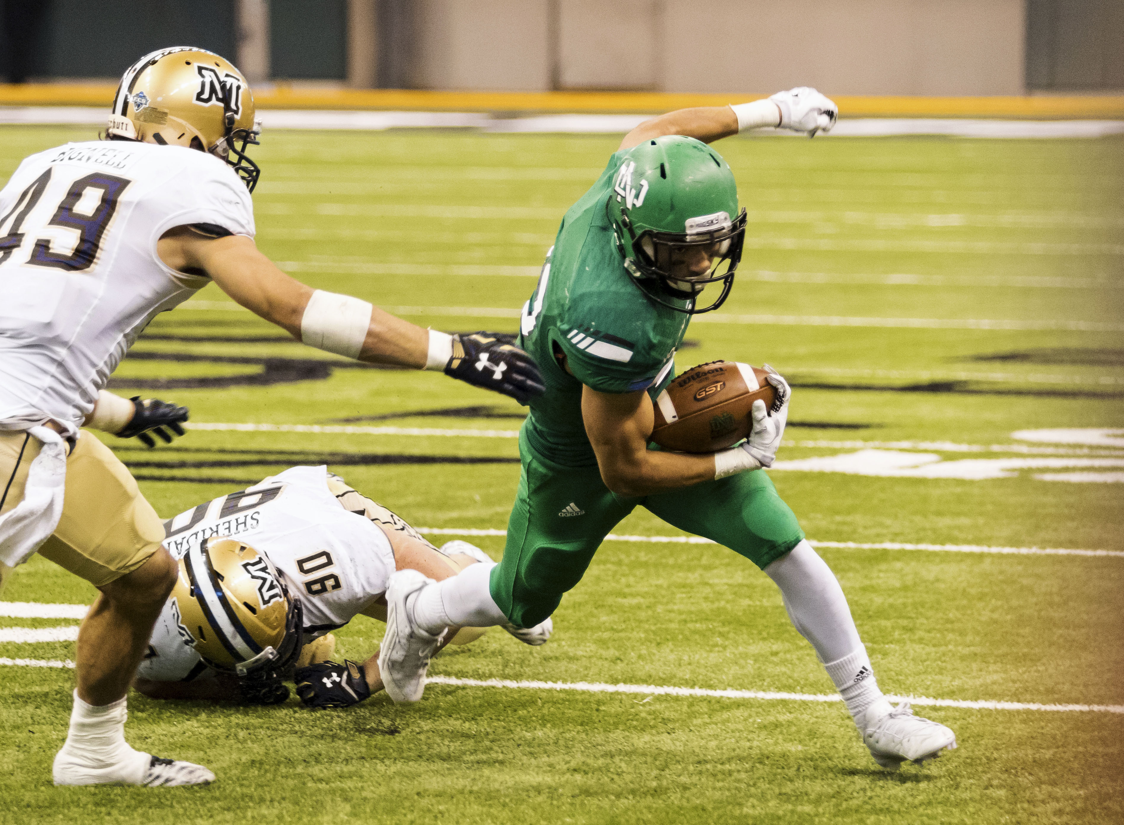 In this Oct. 31, 2015 photo, provided by University of North Dakota Athletics, North Dakota freshman running back John Santiago rushes against Montana State during an NCAA college football game in Grand Forks, N.D. Santiago is the fifth leading rusher in