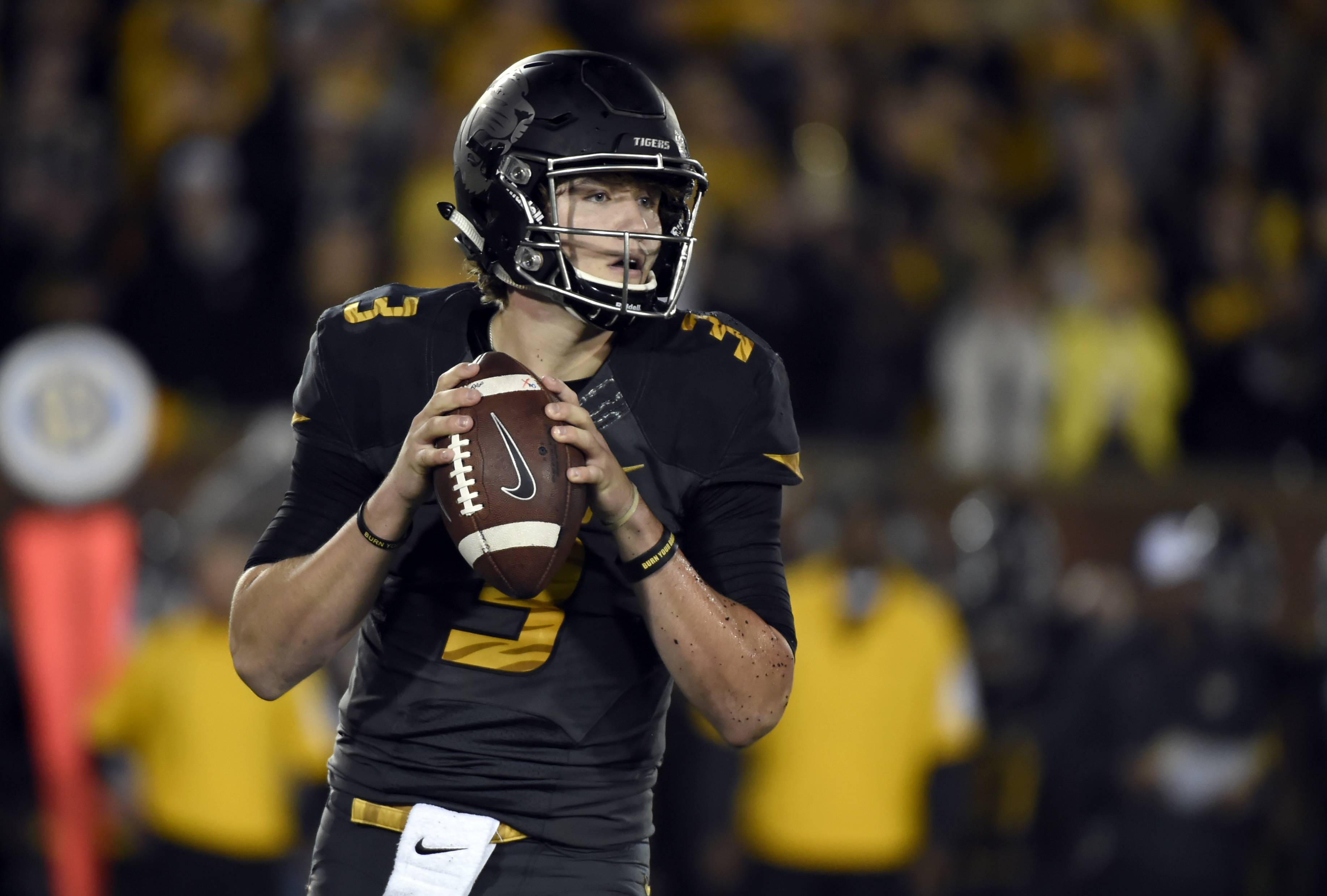 Missouri quarterback Drew Lock drops back to pass during the first half of an NCAA college football game against Mississippi State on Thursday, Nov. 5, 2015, in Columbia, Mo. (AP Photo/L.G Patterson)