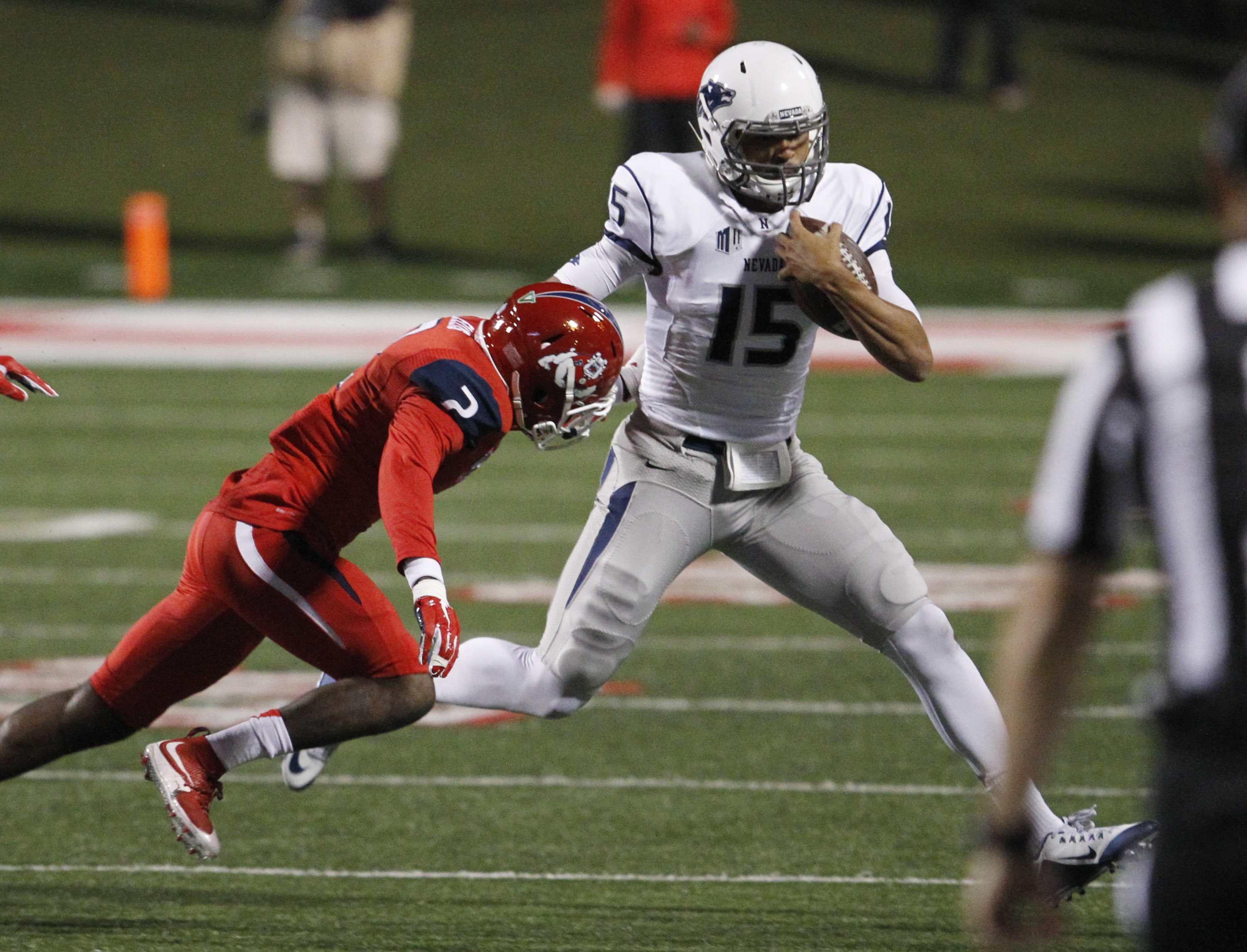 Nevada''s Tyler Stewart runs away from Fresno State's Jamal Ellis during the first half of an NCAA college football game in Fresno, Calif., Thursday, Nov. 5, 2015. (AP Photo/Gary Kazanjian)