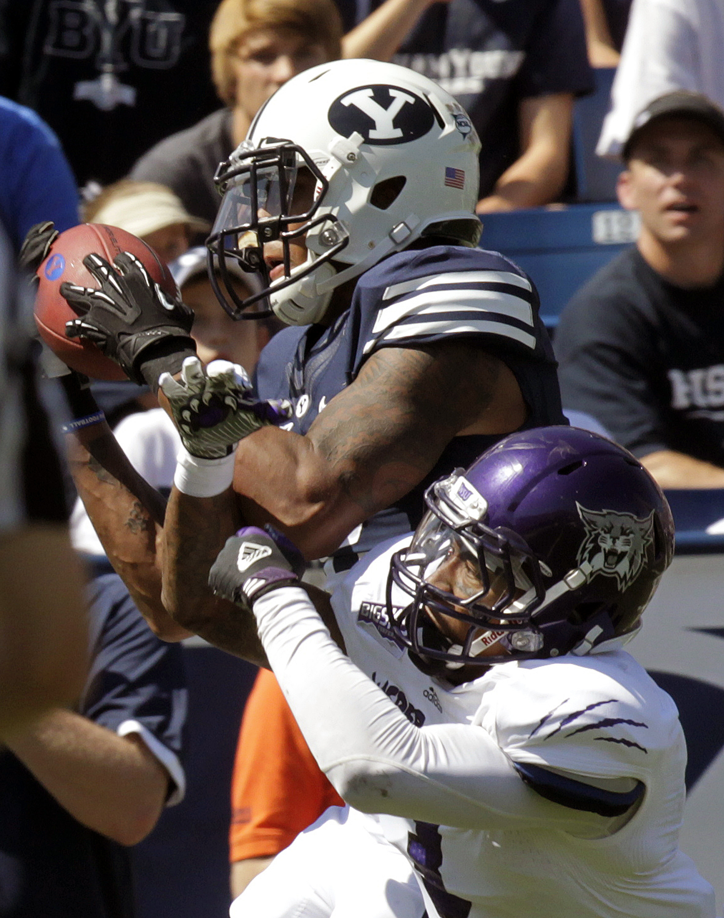 FILE - In this Sept. 8, 2012, file photo, Brigham Young wide receiver Cody Hoffman, top, catches a touchdown pass as then-Weber State cornerback Devin Pugh defends in the first quarter of an NCAA college football game, in Provo, Utah. Former Weber State c