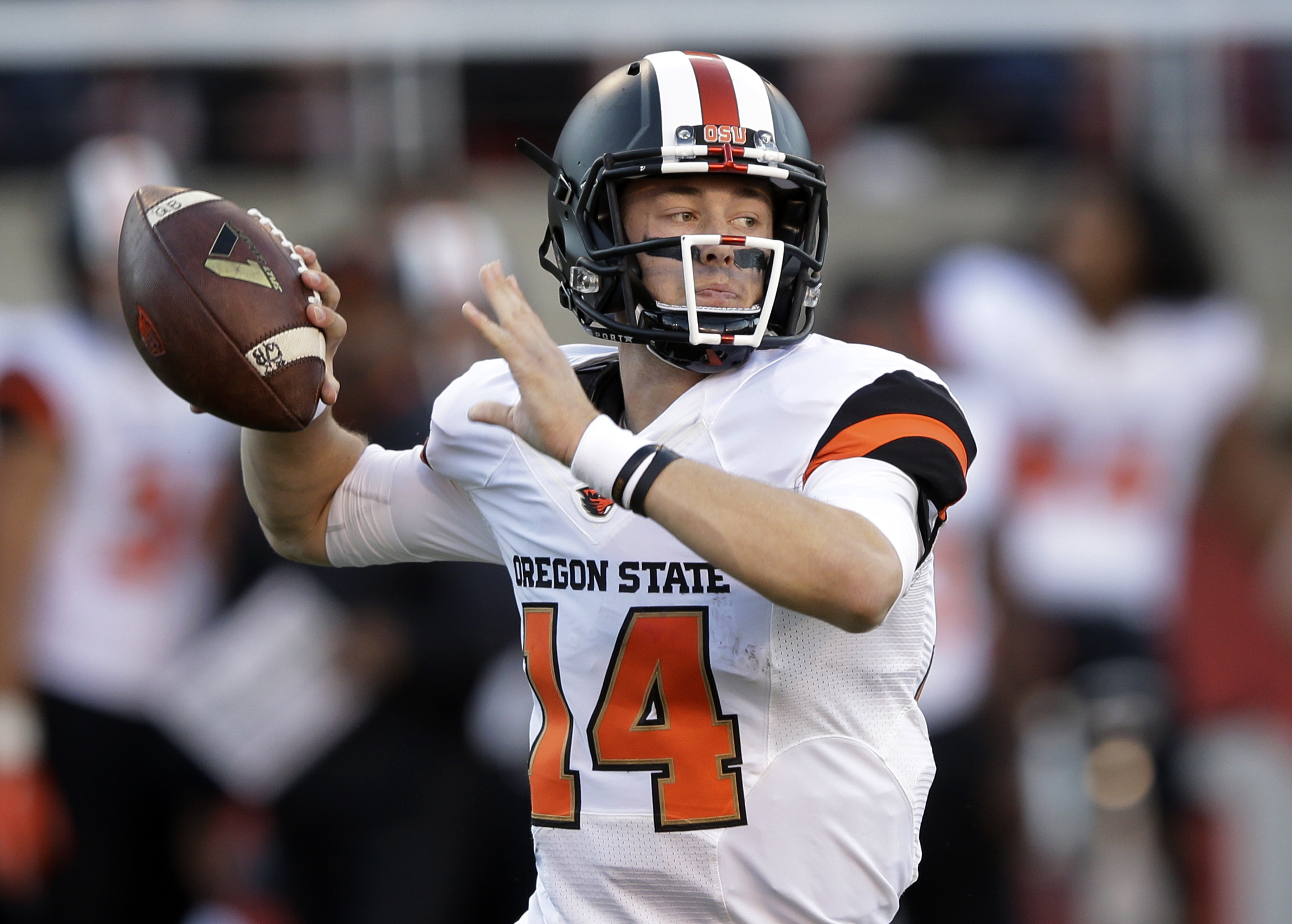 FILE - In this Oct. 31, 2015, file photo, Oregon State quarterback Nick Mitchell prepares to pass the ball against Utah in the first quarter during an NCAA college football game, in Salt Lake City. Mitchell's first tests at starting quarterback for Oregon