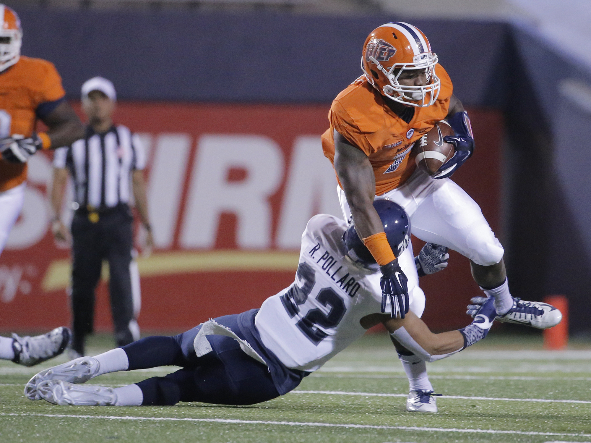 Rice cornerback Ryan Pollard tackles UTEP running back LaQuintus Dowell during the first half of an NCAA college football game Friday, Nov. 6, 2015, in El Paso, Texas. (Mark Lambie/El Paso Times via AP)