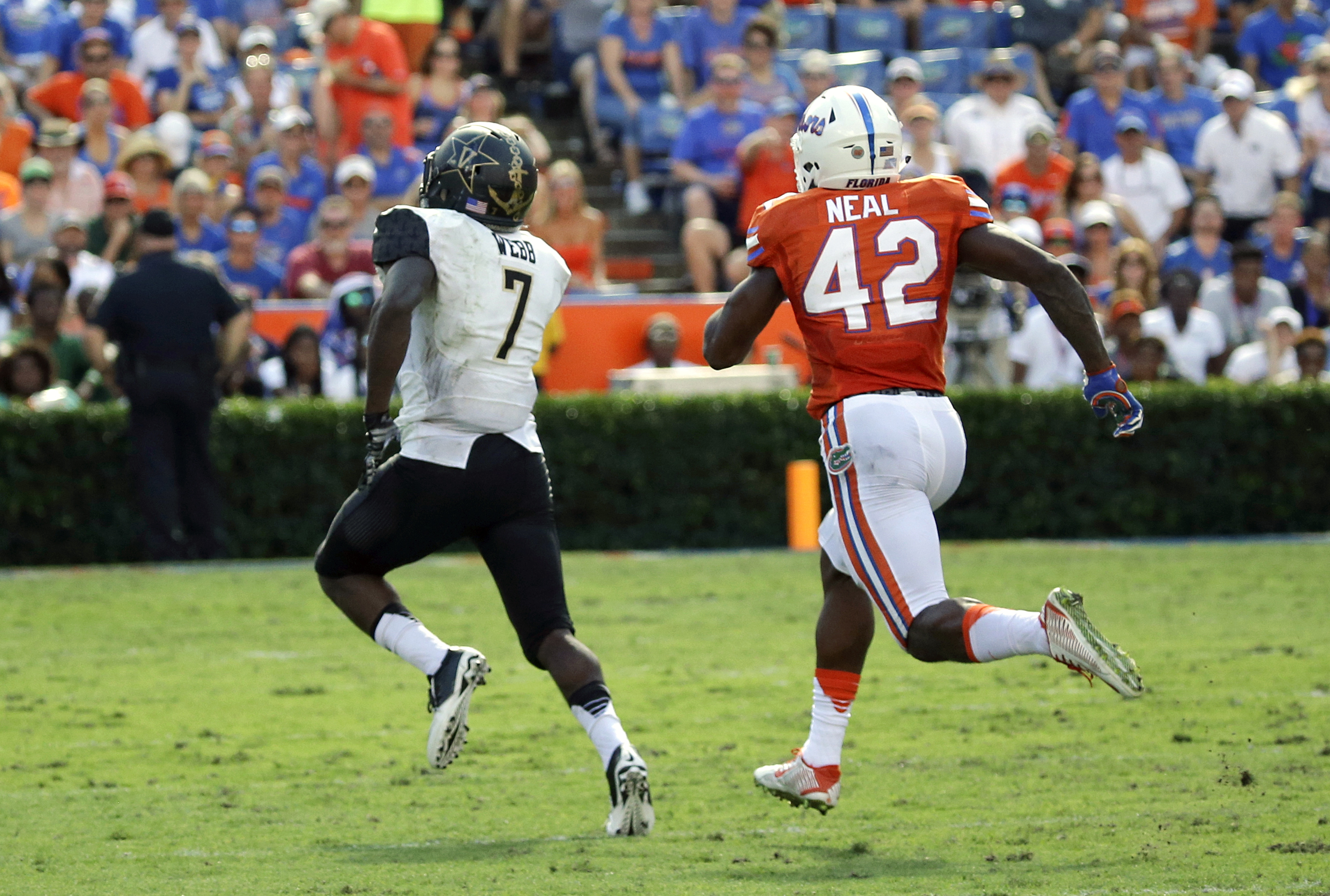 Vanderbilt running back Ralph Webb (7) runs past Florida defensive back Keanu Neal (42) on his way to a 74-yard touchdown during the first half of an NCAA college football game, Saturday, Nov. 7, 2015, in Gainesville, Fla. (AP Photo/John Raoux)