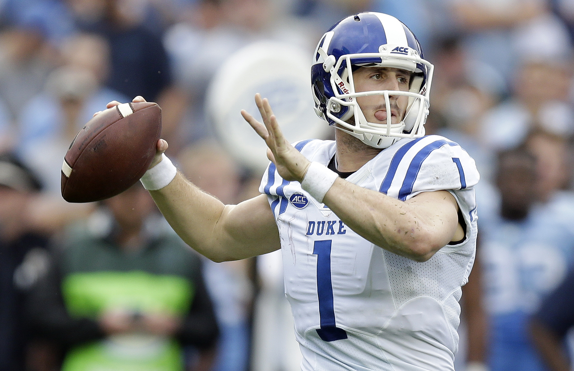 Duke quarterback Thomas Sirk (1) looks to pass against North Carolina during the first half of an NCAA college football game in Chapel Hill, N.C., Saturday, Nov. 7, 2015. (AP Photo/Gerry Broome)
