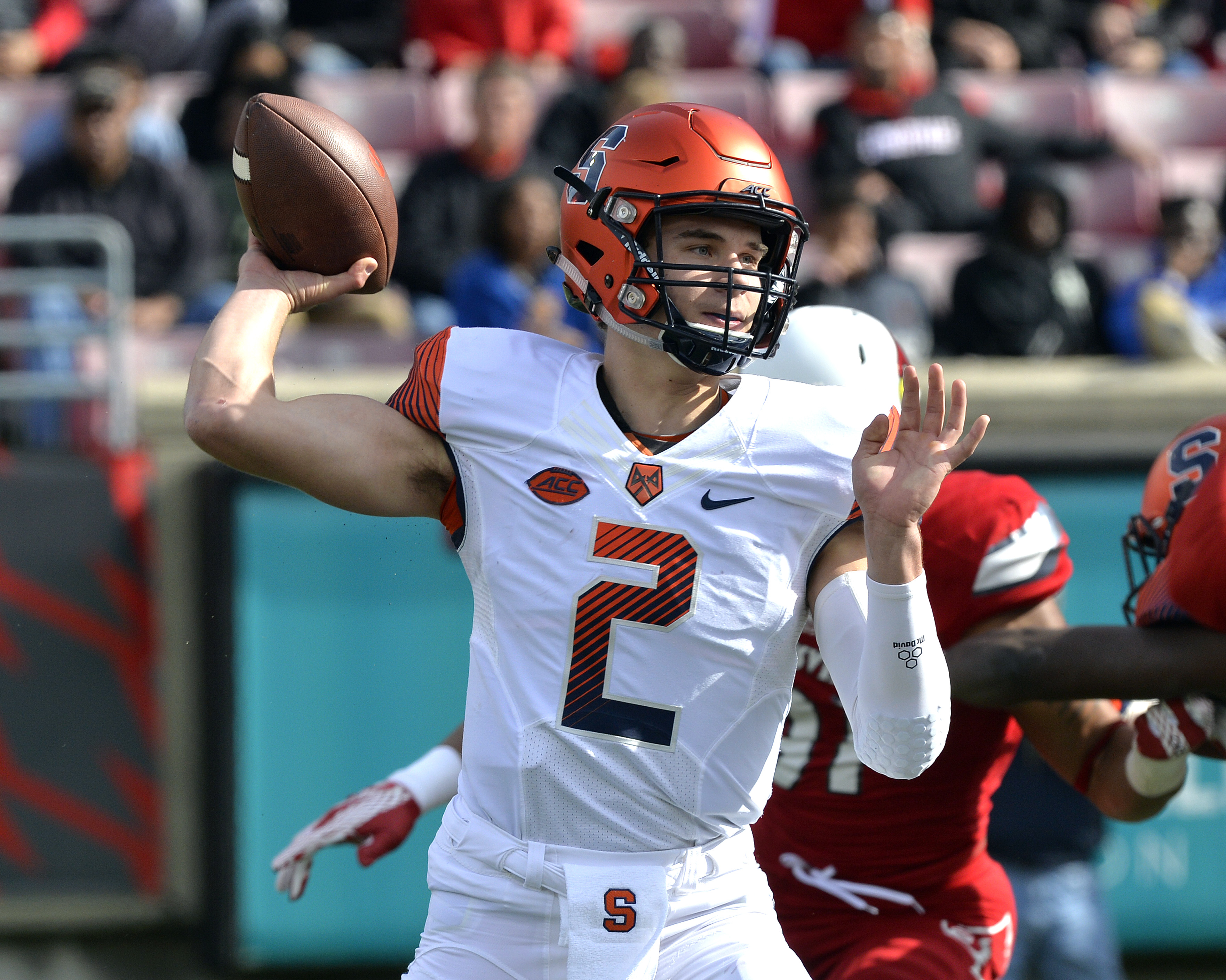 Syracuse quarterback Eric Dungey (2) attempts a pass during the first half of an NCAA college football game against Louisville, Saturday, Nov. 7, 2015, in Louisville, Ky. (AP Photo/Timothy D. Easley)