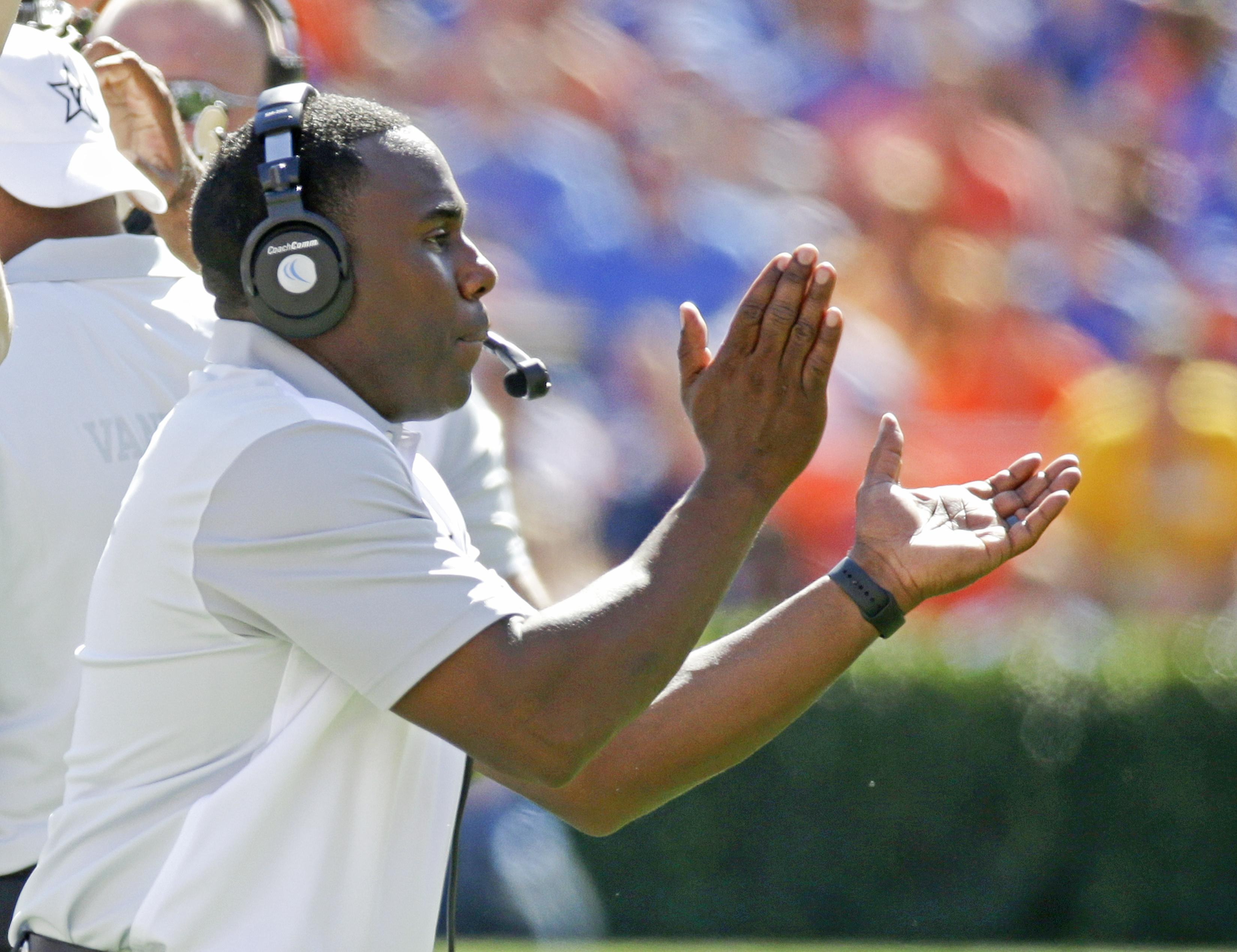 Vanderbilt head coach Derek Mason encourages his team during the first half of an NCAA college football game against Florida , Saturday, Nov. 7, 2015, in Gainesville, Fla. (AP Photo/John Raoux)