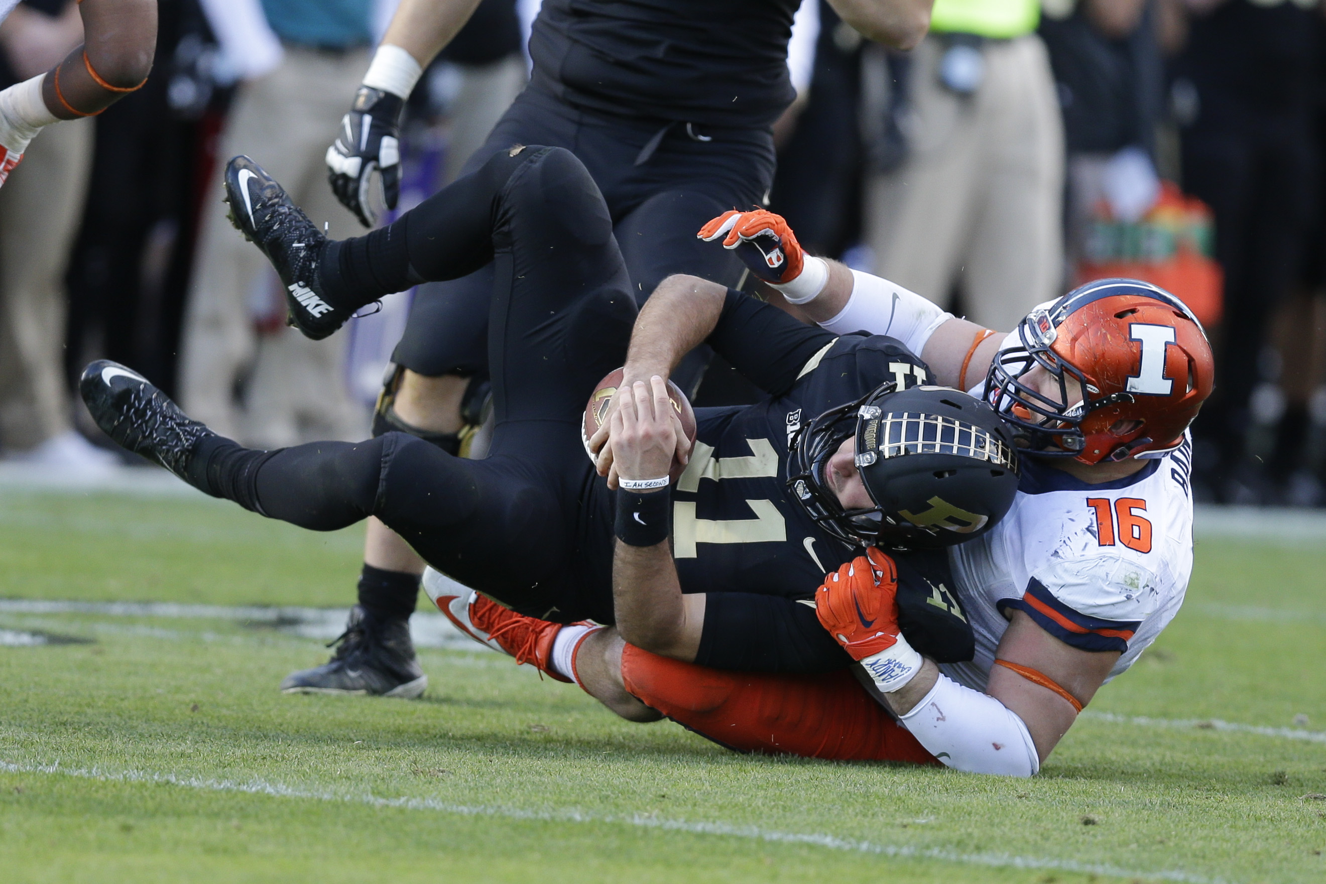 Illinois defensive lineman Jihad Ward (17) sacks Purdue quarterback David Blough (11) during the second half of an NCAA college football game in West Lafayette, Ind., Saturday, Nov. 7, 2015. Illinois defeated Purdue 48-14. (AP Photo/Michael Conroy)