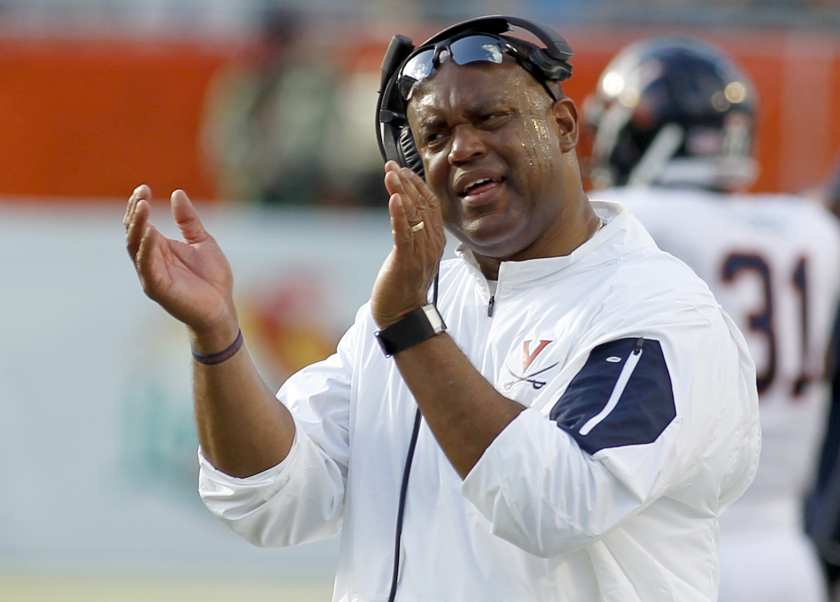 Virginia head coach Mike London reacts on the sidelines in the second quarter of play against Miami in an NCAA college football game, Saturday, Nov. 7, 2015, in Miami Gardens, Fla. (AP Photo/Joe Skipper)