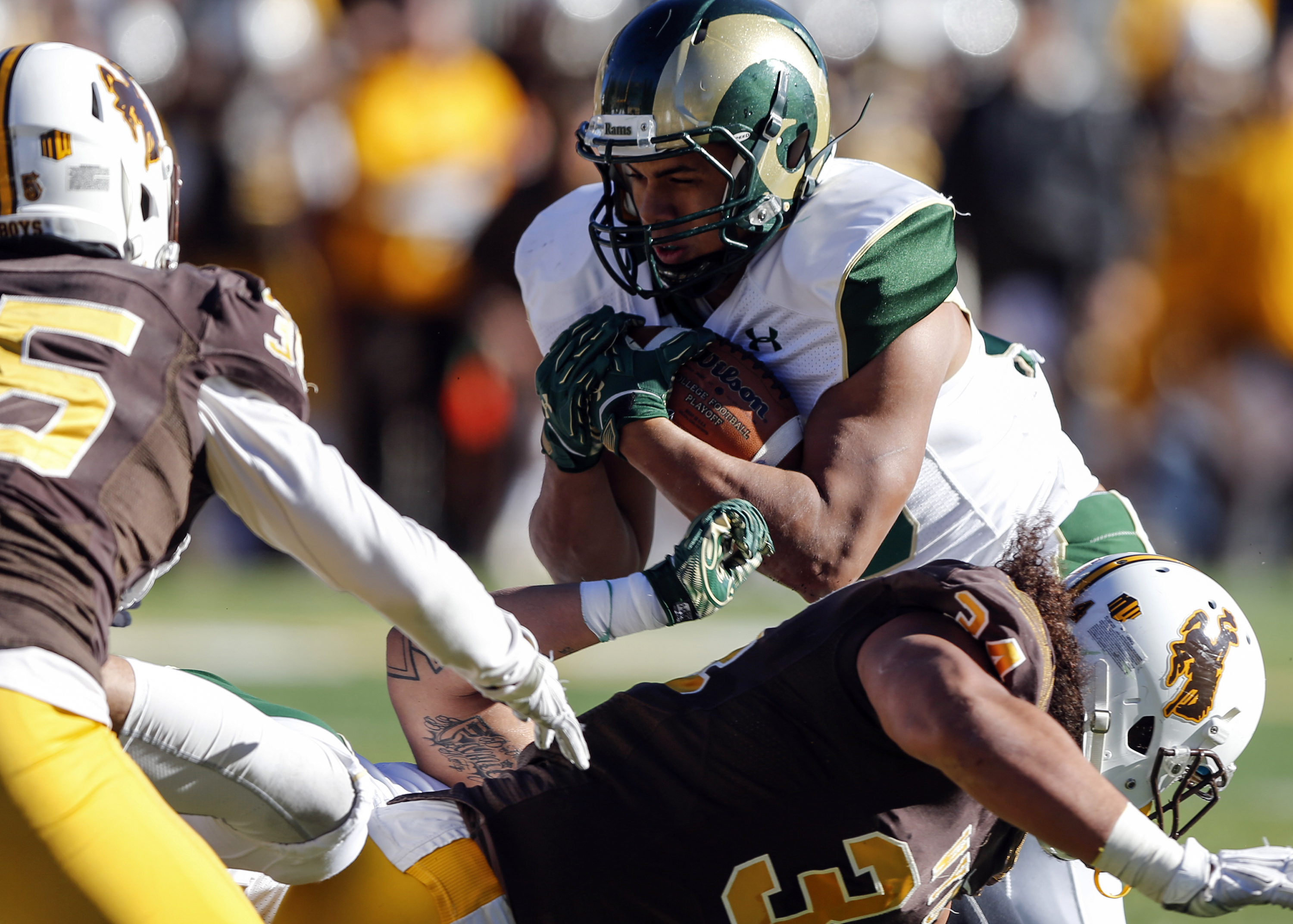 Colorado State's unning back Izzy Matthews runs into the end zone against Wyoming defenders during the second quarter of an NCAA college football game, Saturday, Nov. 7, 2015, in Laramie, Wyo. (AP Photo/Michael Smith)
