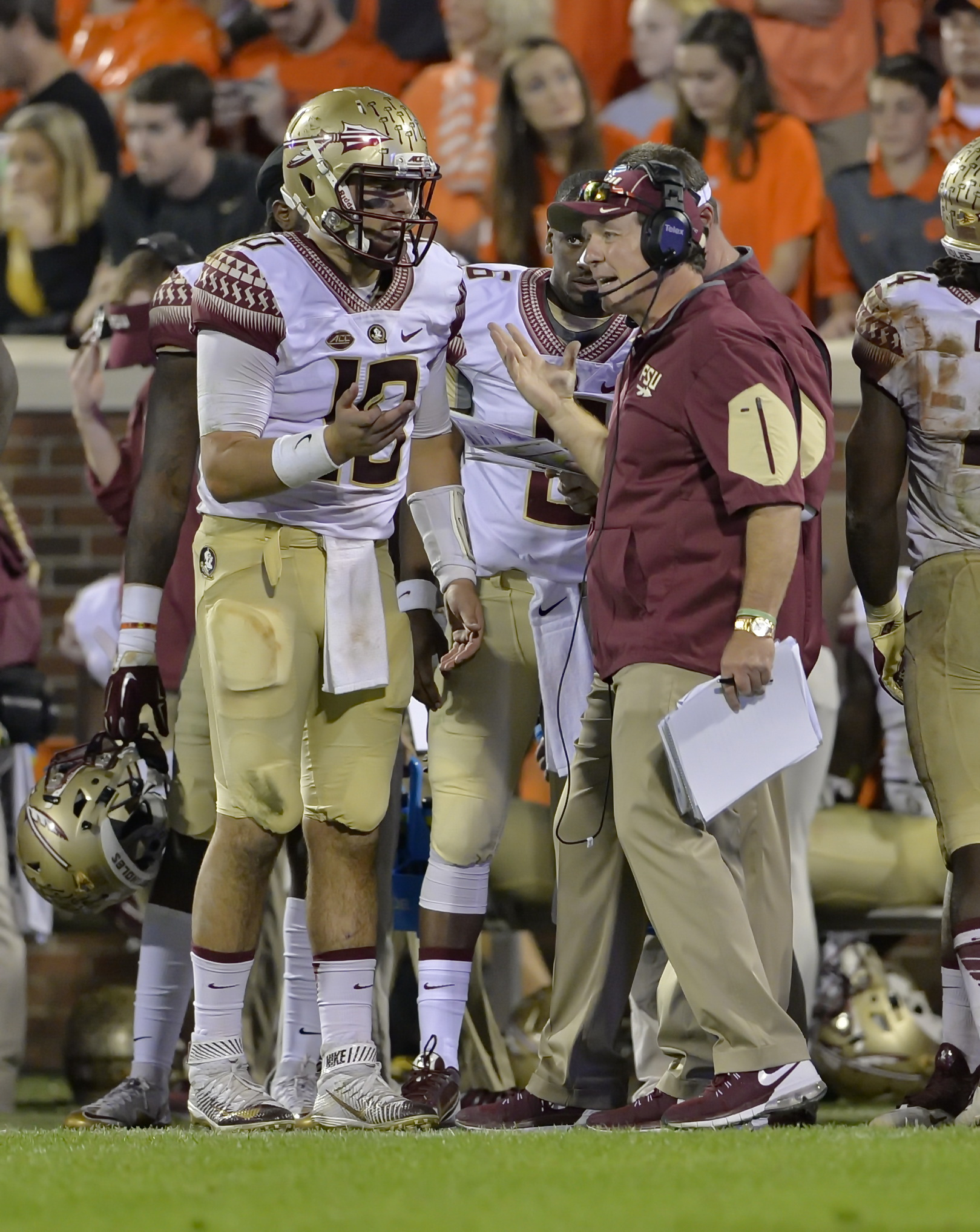 Florida State head coach Jimbo Fisher, right, talks to quarterback Sean Maguire during the second half of an NCAA college football game against Clemson Saturday, Nov. 7, 2015,  in Clemson,  S.C.  Clemson won 23-13. (AP Photo/Richard Shiro)