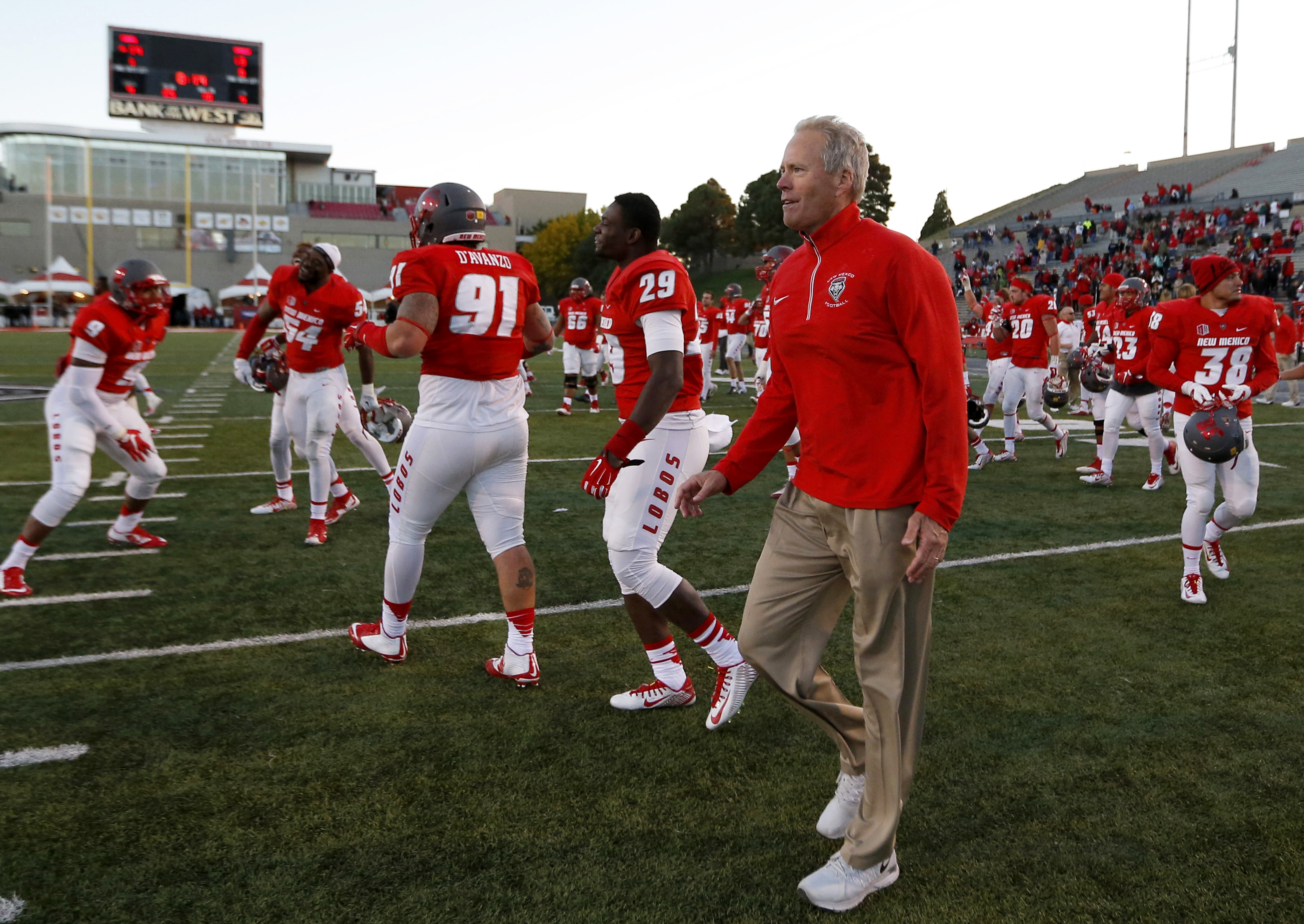 New Mexico head coach Bob Davie celebrates along his players at the end of an NCAA college football game against Utah State in Albuquerque, N.M., Saturday, Nov. 7, 2015. New Mexico won 14-13. (AP Photo/Andres Leighton)