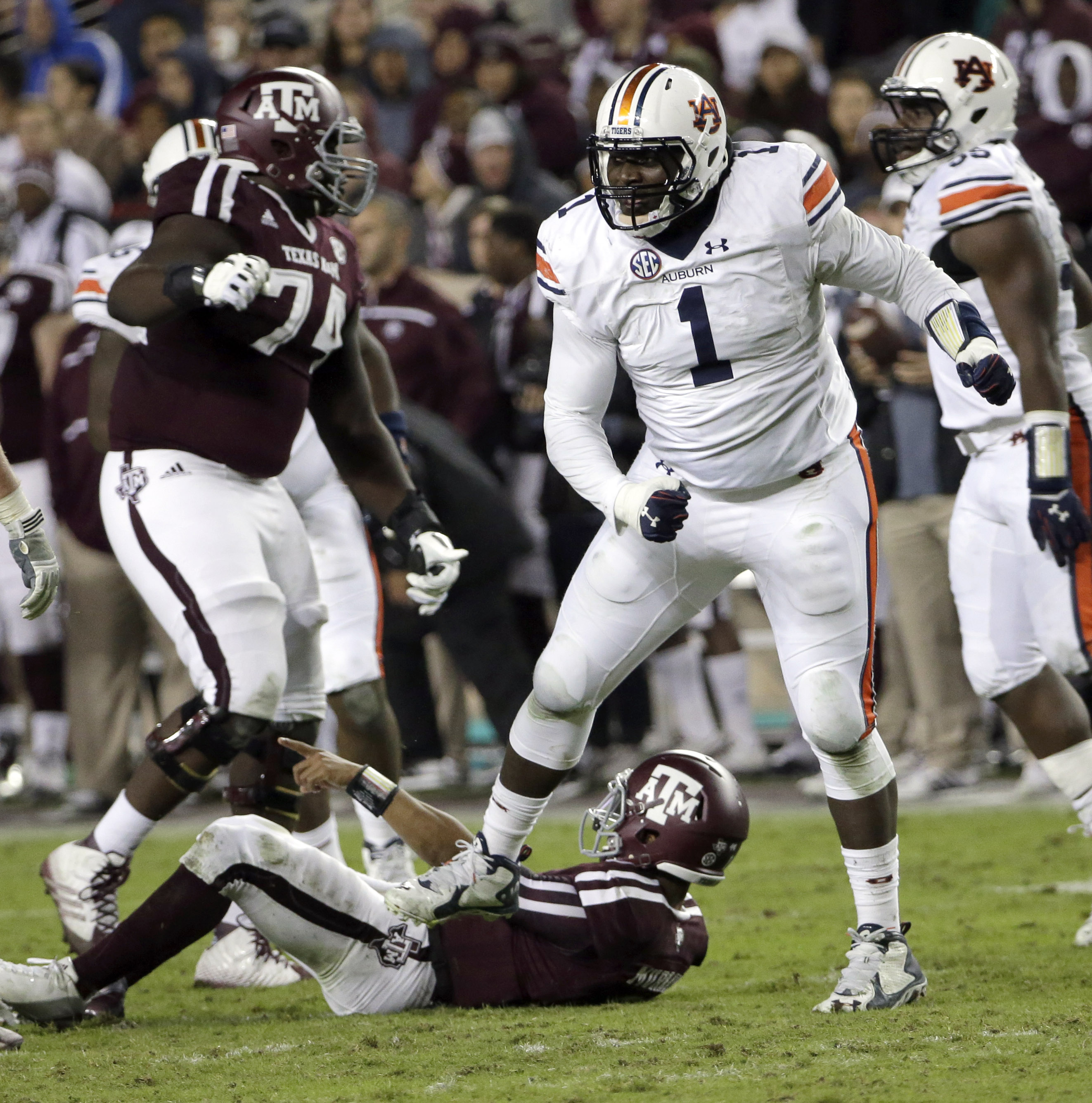 Auburn defensive tackle Montravius Adams (1) celebrates after sacking Texas A&M quarterback Kyler Murray, bottom, during the second quarter of an NCAA college football game Saturday, Nov. 7, 2015, in College Station, Texas. (AP Photo/David J. Phillip)
