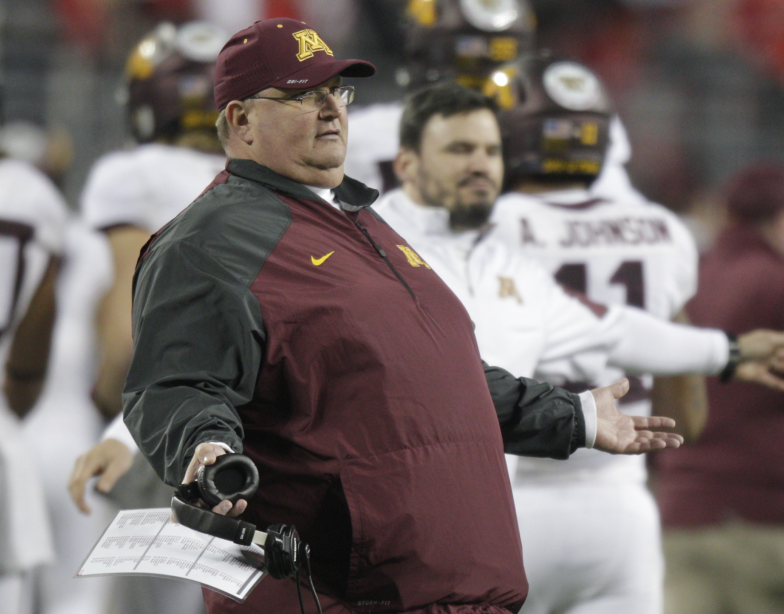 Minnesota interim head coach Tracy Claeys questions a referee during the second quarter of an NCAA college football game against Ohio State Saturday, Nov. 7, 2015, in Columbus, Ohio. (AP Photo/Jay LaPrete)