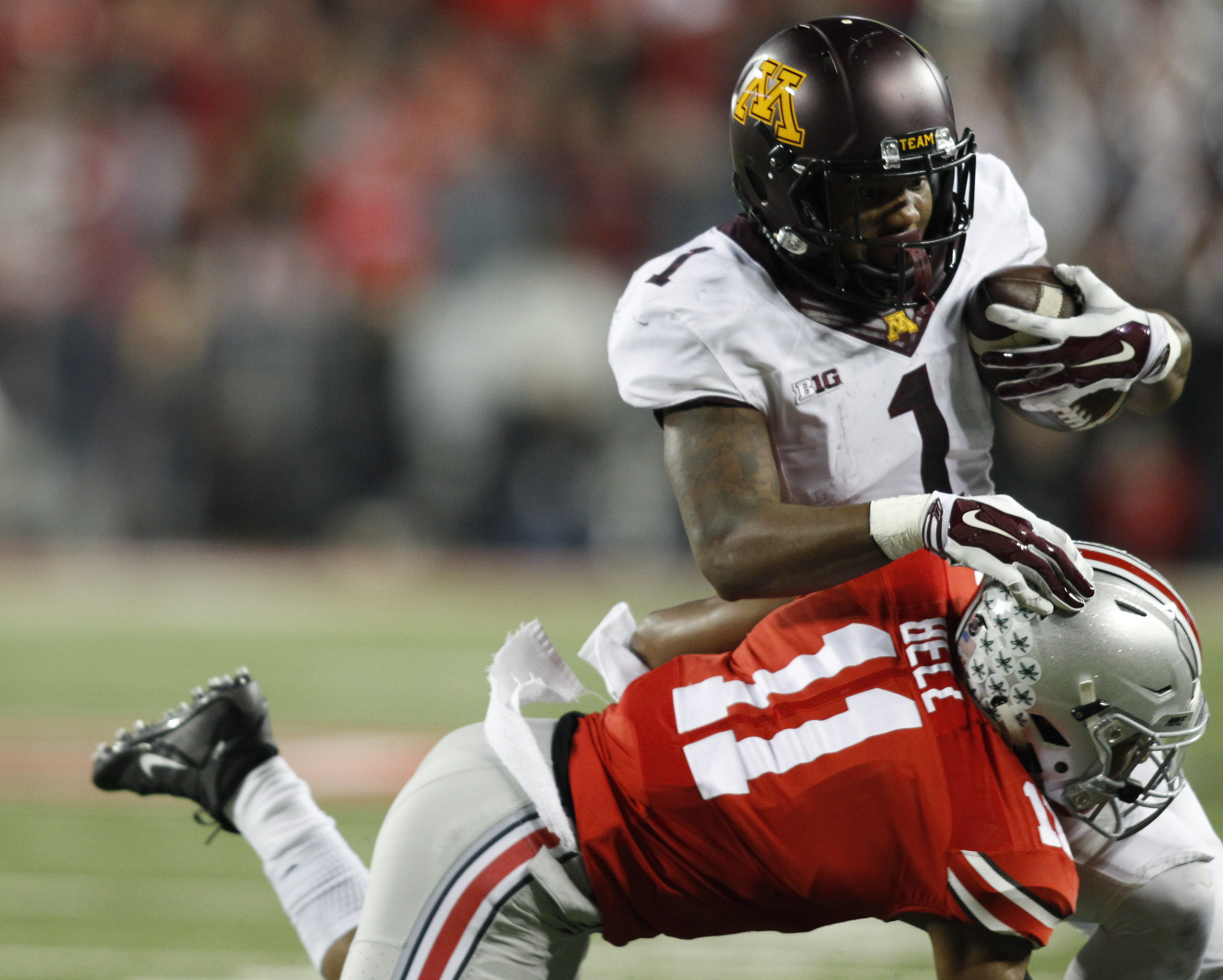 Minnesota wide receiver K.J. Maye, top, is tackled by Ohio State safety Vonn Bell during the fourth quarter of an NCAA college football game Saturday, Nov. 7, 2015, in Columbus, Ohio. Ohio State beat Minnesota 28-14. (AP Photo/Paul Vernon)