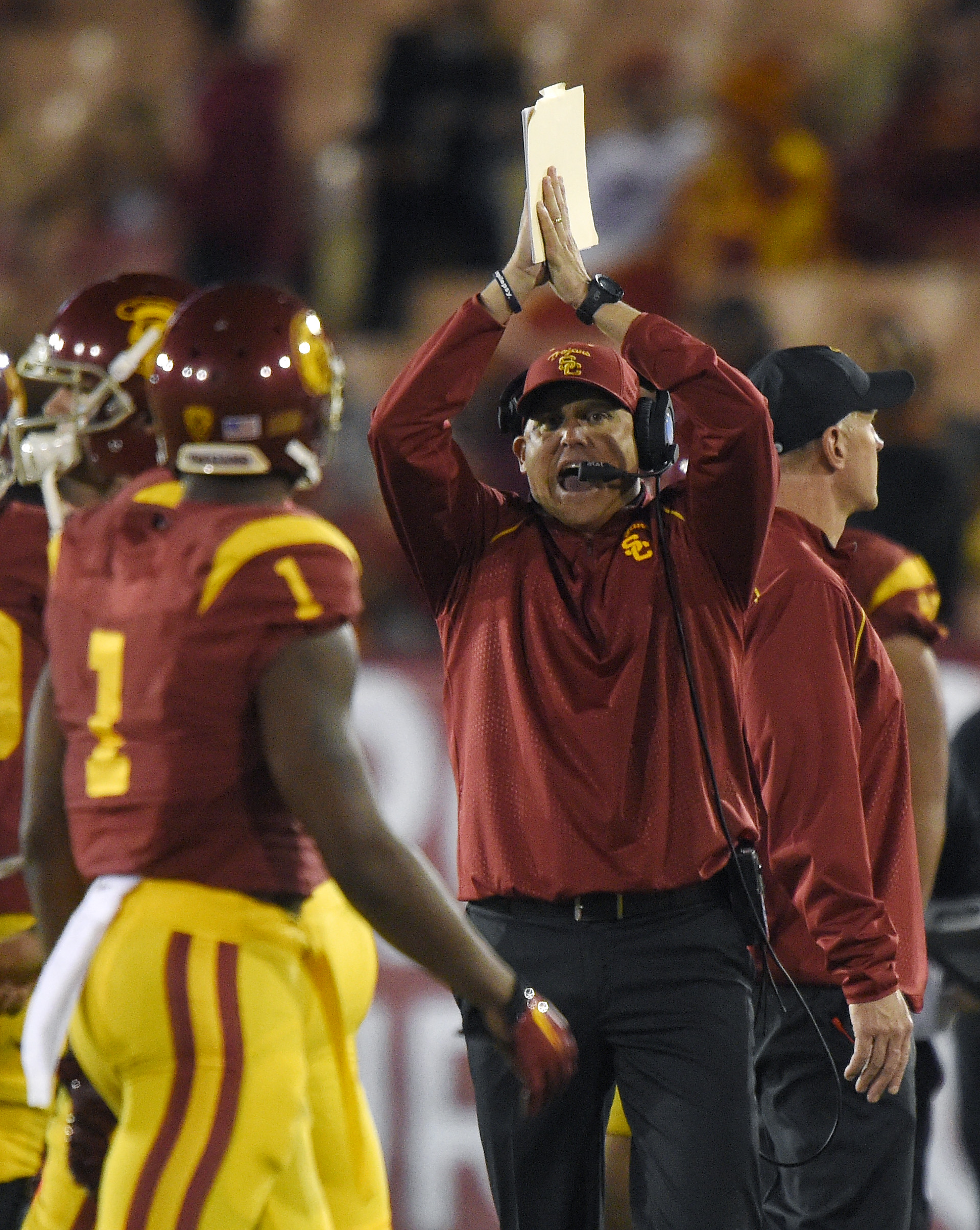 Southern California interim head coach Clay Helton, right, gestures as wide receiver Darreus Rogers watches during the second half of an NCAA college football game against Arizona, Sunday, Nov. 8, 2015, in Los Angeles. Southern California won 38-30. (AP P