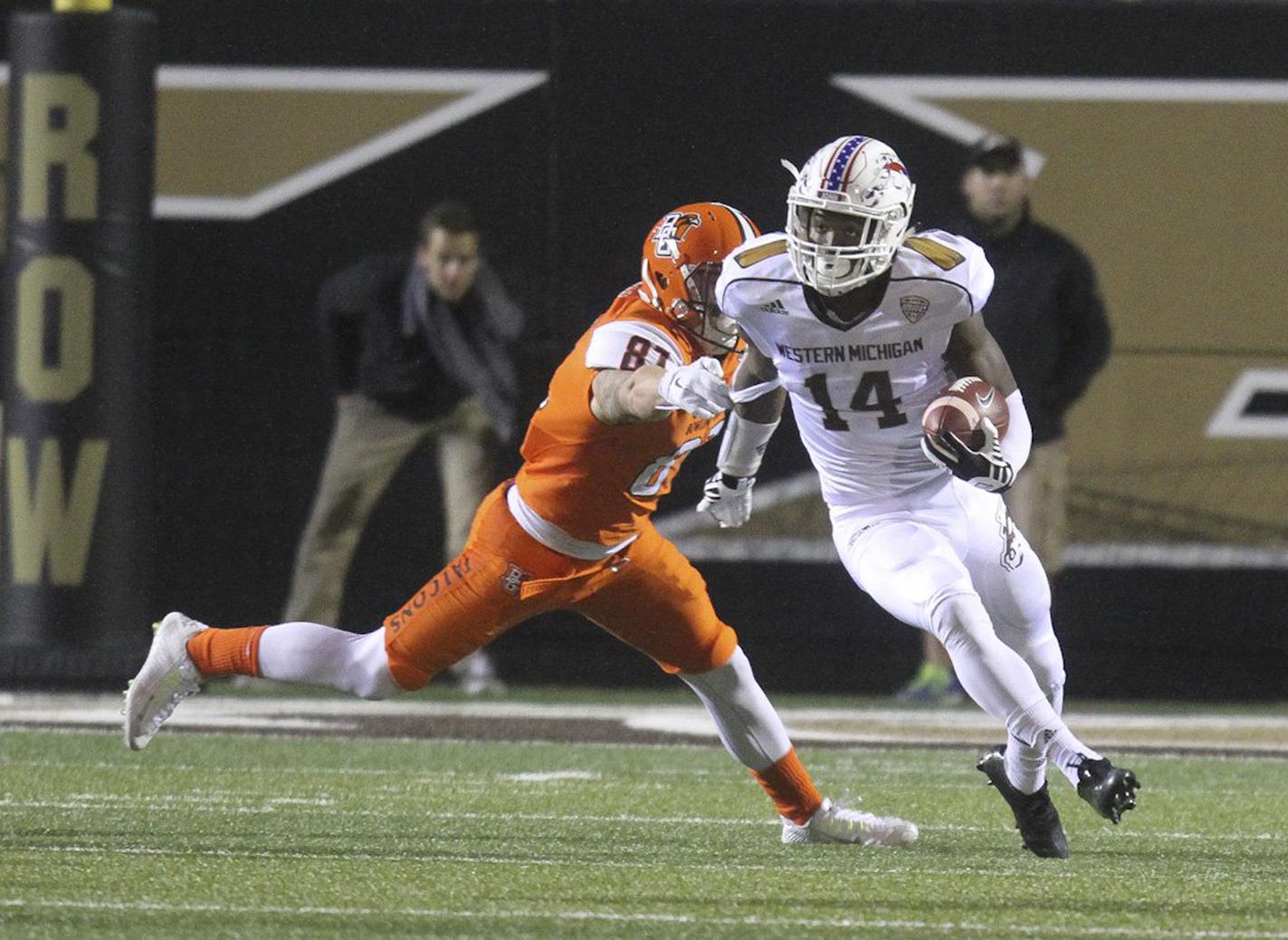 Western Michigan's Darius Phillips (14) carries against Bowling Green during an NCAA college football game Wednesday night, Nov. 11, 2015, in Kalamazoo, Mich. (Daytona Niles/The Gazette via AP