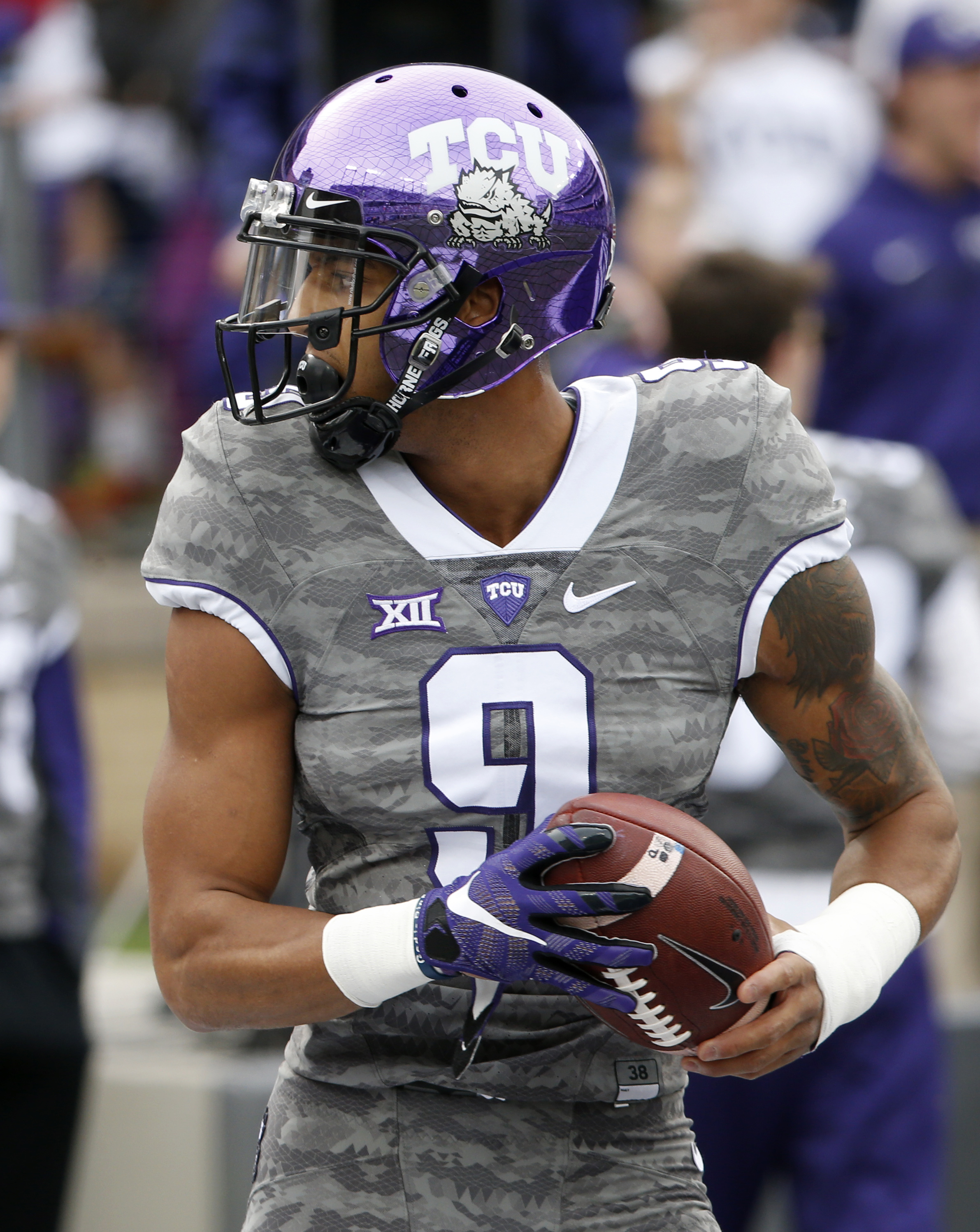 TCU wide receiver Josh Doctson (9) goes through warm-ups before TCU takes on Kansas in an NCAA college football game Saturday, Nov. 14, 2015, in Fort Worth, Texas. (AP Photo/Ron Jenkins)