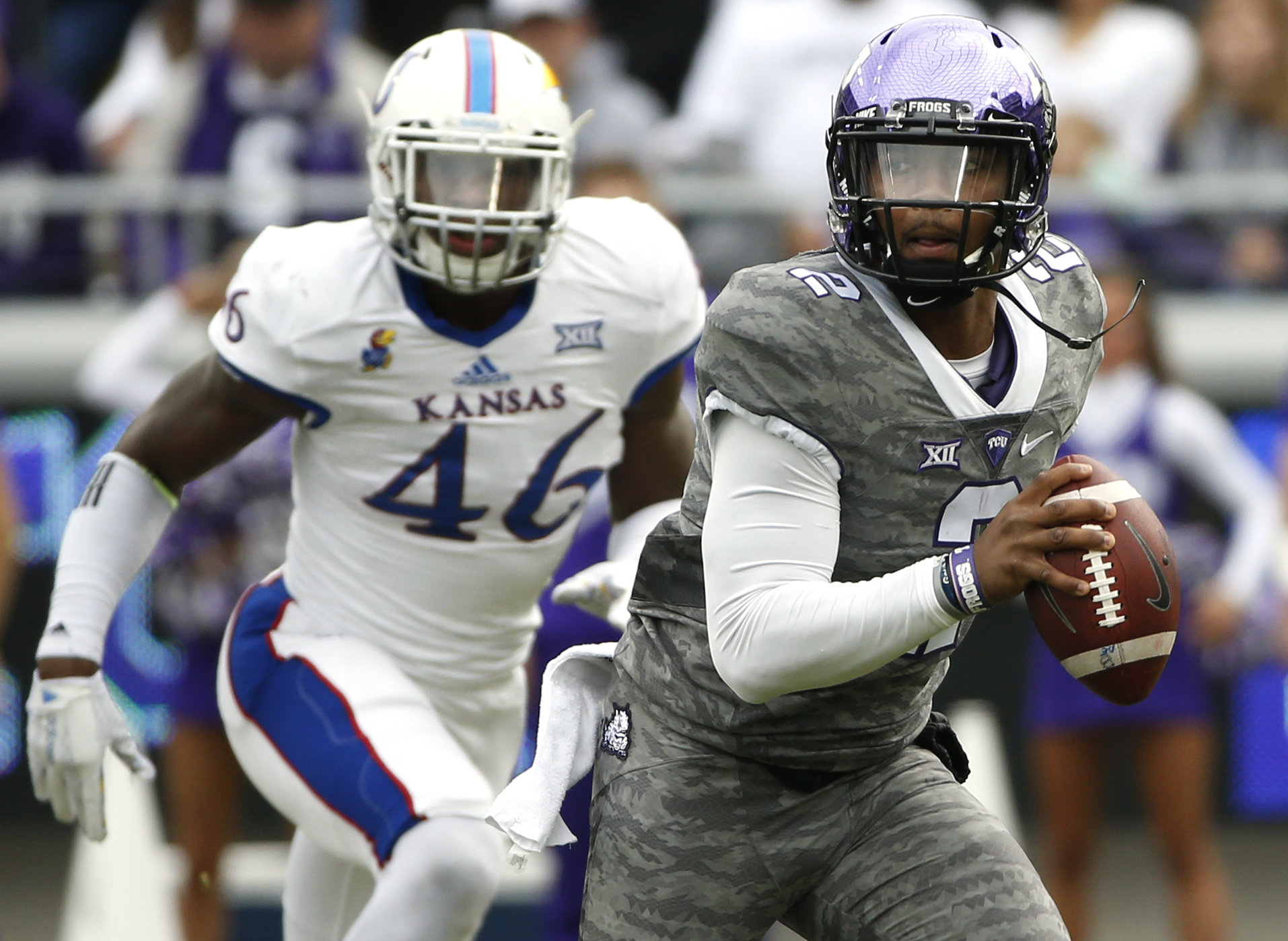 TCU quarterback Trevone Boykin (2) runs against Kansas defensive end Dorance Armstrong Jr. (46) in the first quarter of an NCAA college football game Saturday, Nov. 14, 2015, in Fort Worth, Texas. (AP Photo/Ron Jenkins)