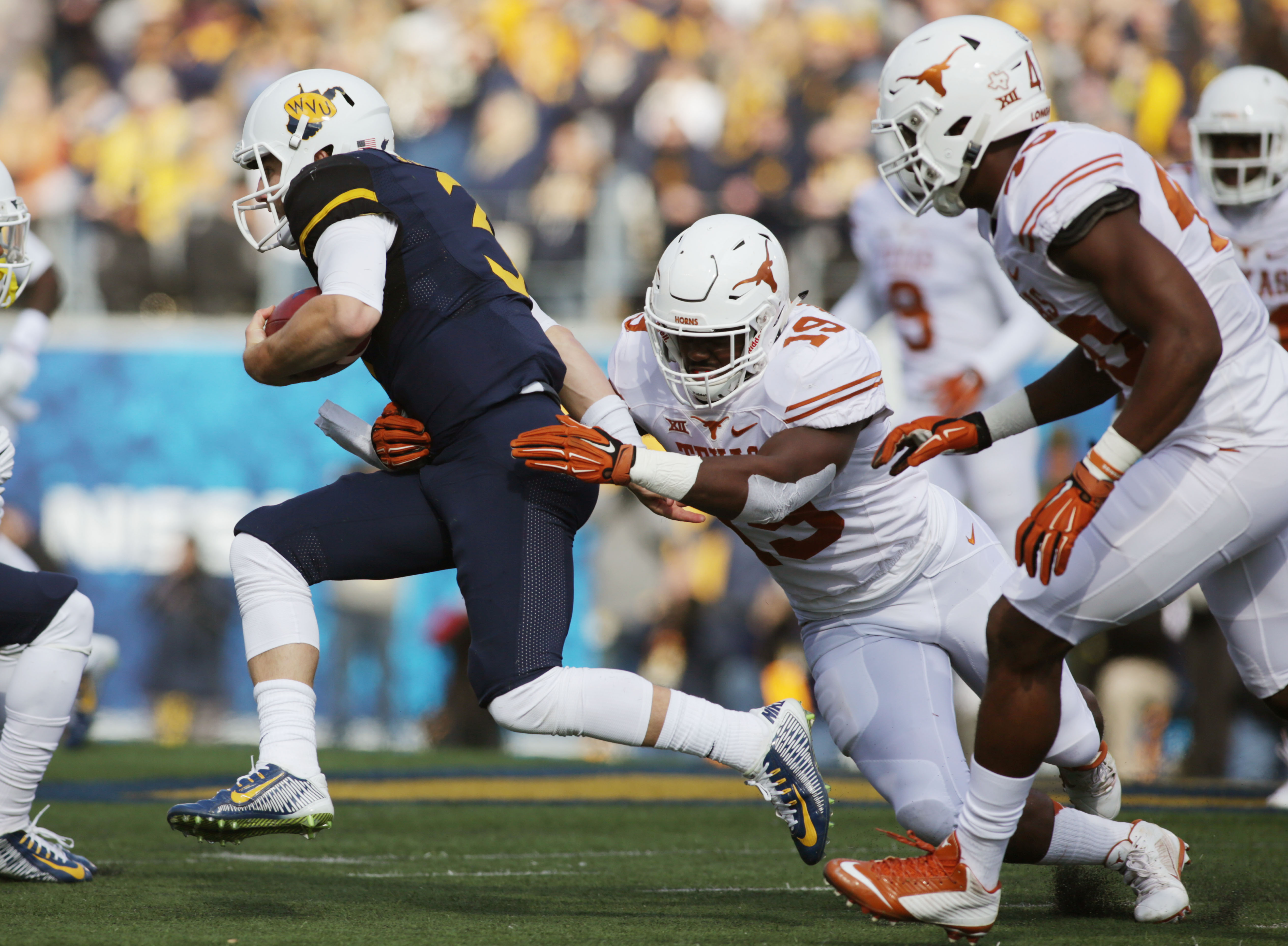 West Virginia quarterback Skyler Howard (3) is sacked by Texas linebacker Peter Jinkens (19) during the first half/ of an NCAA college football game, Saturday, Nov. 14, 2015, in Morgantown, W.Va. (AP Photo/Raymond Thompson)