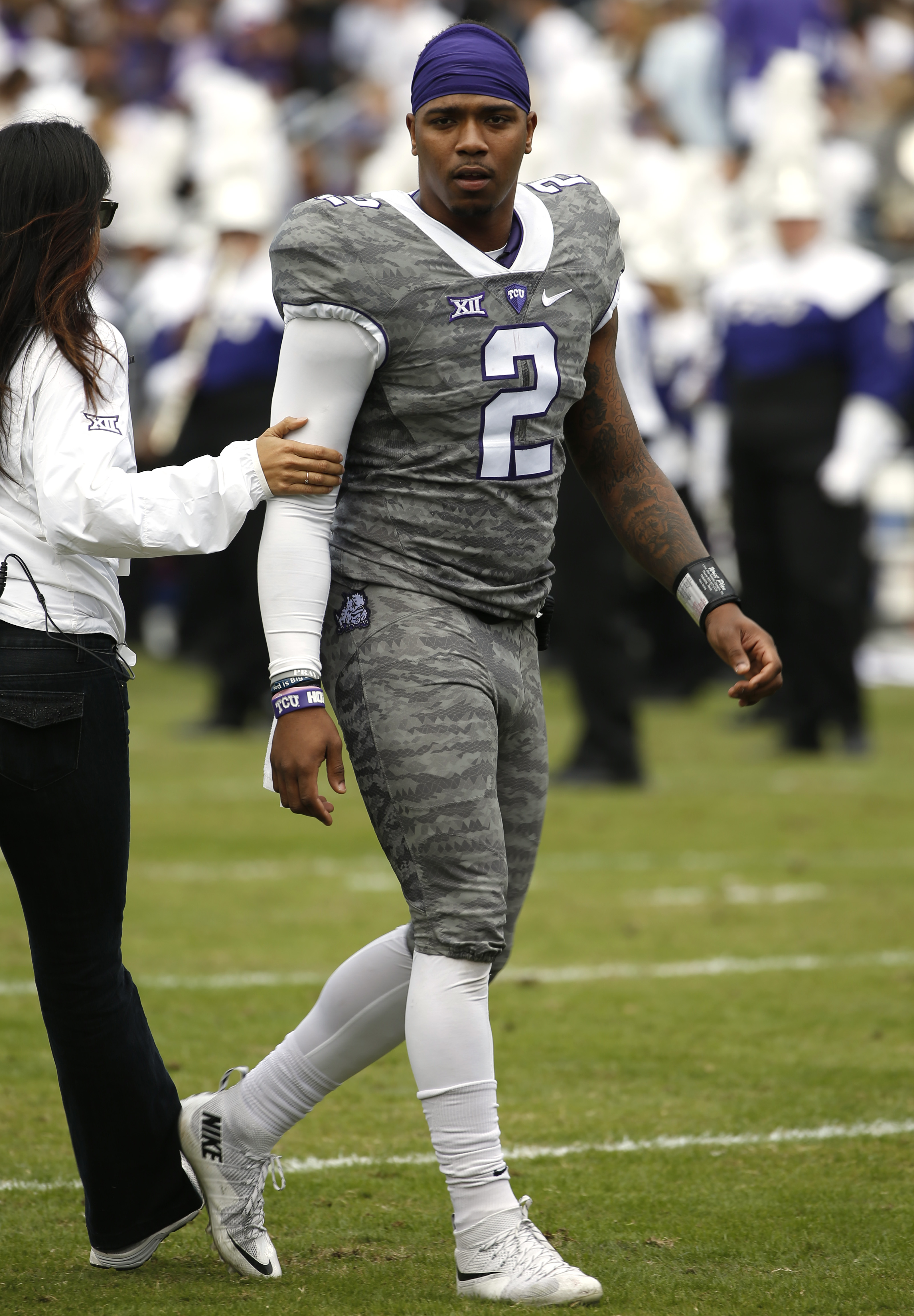 TCU quarterback Trevone Boykin (2) leaves field following the first half against Kansas in of an NCAA college football game Saturday, Nov. 14, 2015, in Fort Worth, Texas. (AP Photo/Ron Jenkins)
