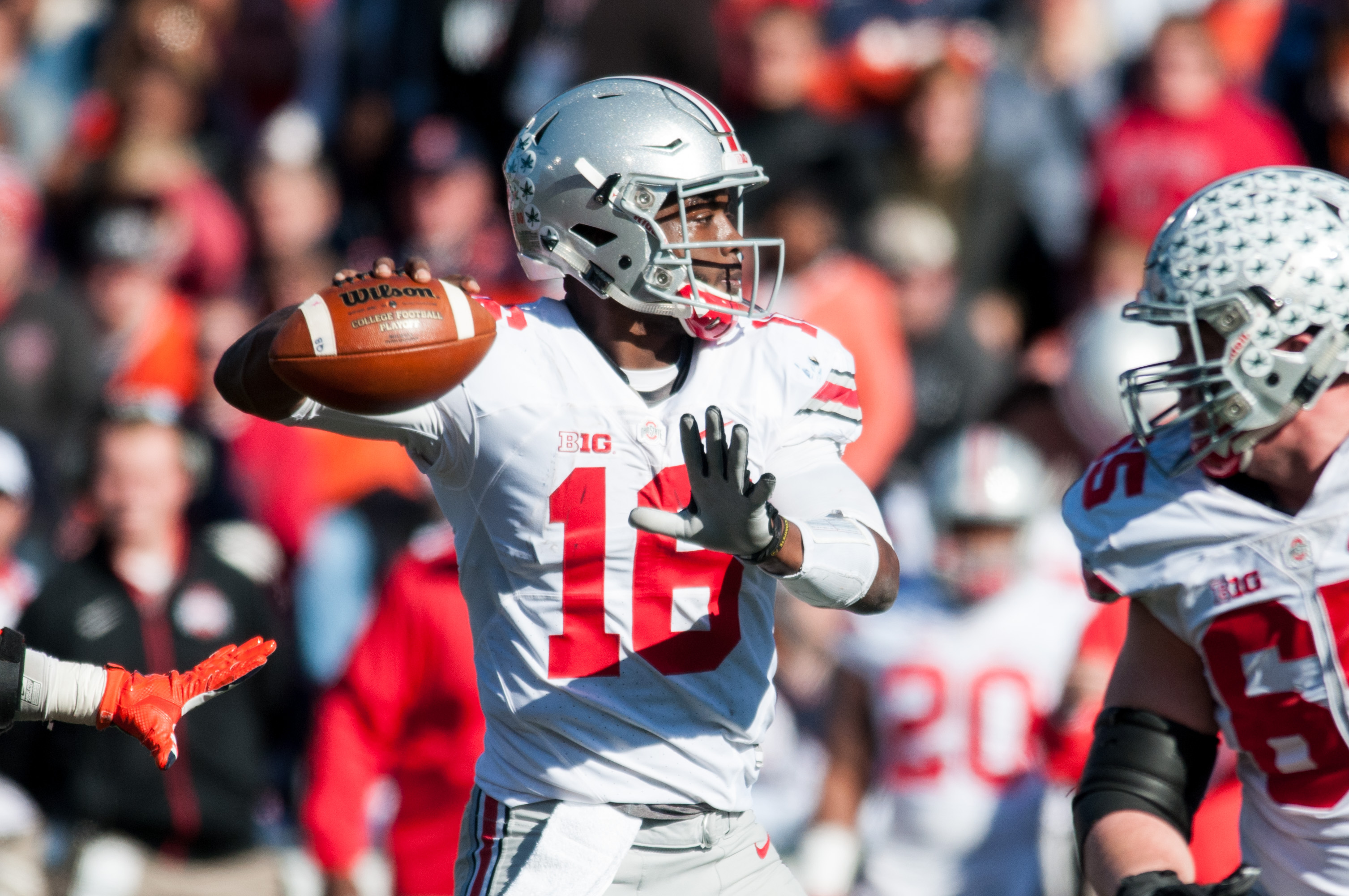 Ohio State quarterback J.T. Barrett (16) throws a pass during the second quarter of an NCAA college football game against Illinois, Saturday, Nov. 14, 2015, at Memorial Stadium in Champaign, Ill.  (AP Photo/Bradley Leeb)
