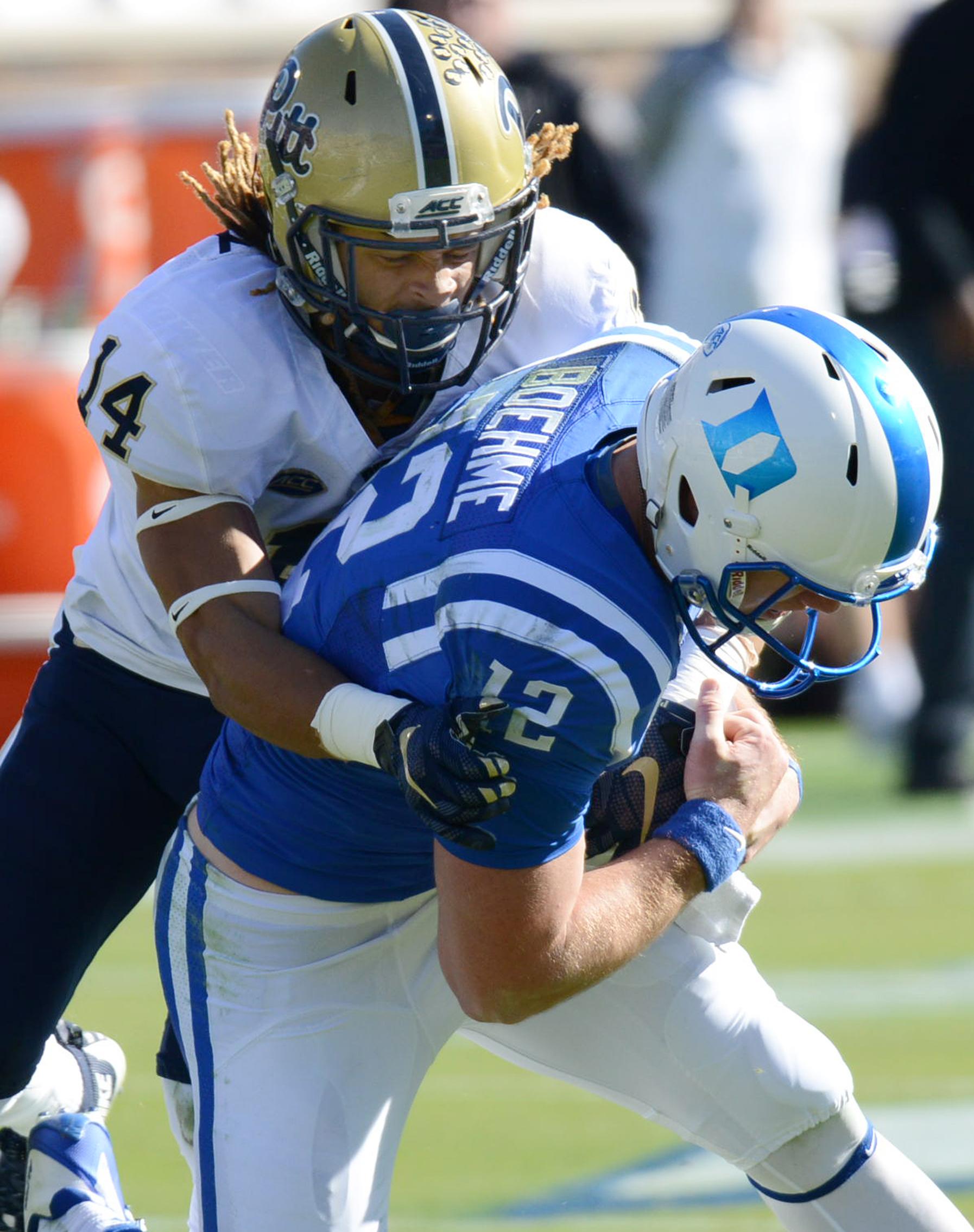 Duke quarterback Parker Boehme (12) is tackled by Pittsburgh's Avonte Maddox (14) during an NCAA college football game Saturday, Nov. 14, 2015, in Durham, N.C. (Bernard Thomas/The Herald-Sun via AP) MANDATORY CREDIT