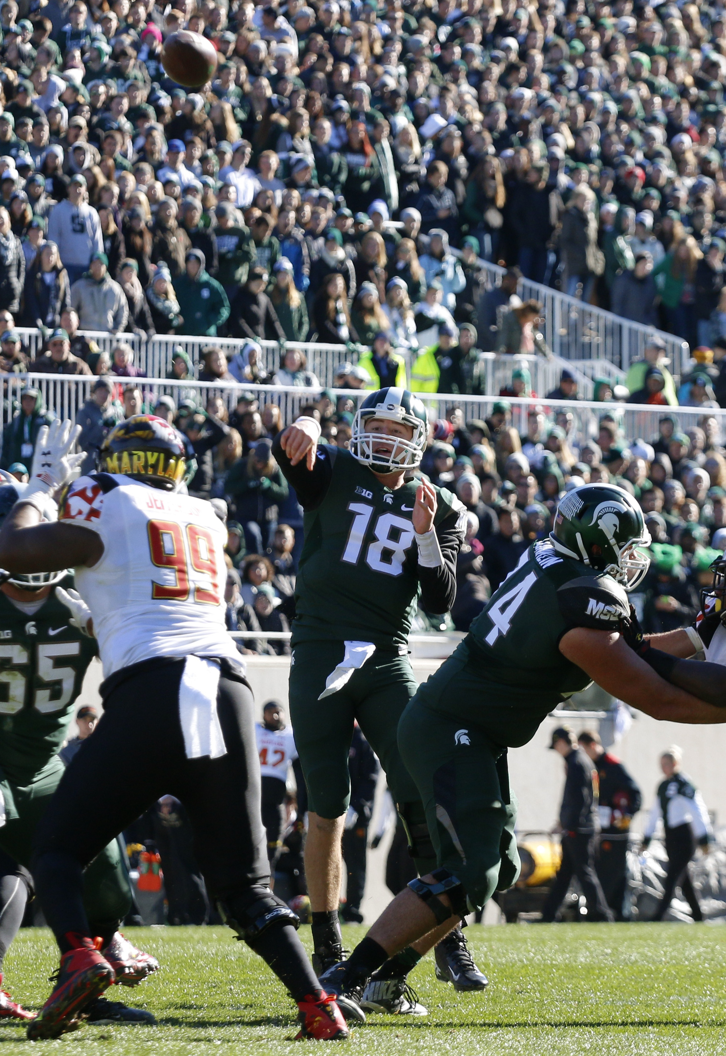Michigan State quarterback Connor Cook (18) throws a pass during the second quarter of an NCAA college football game against Maryland, Saturday, Nov. 14, 2015, in East Lansing, Mich. (AP Photo/Al Goldis)