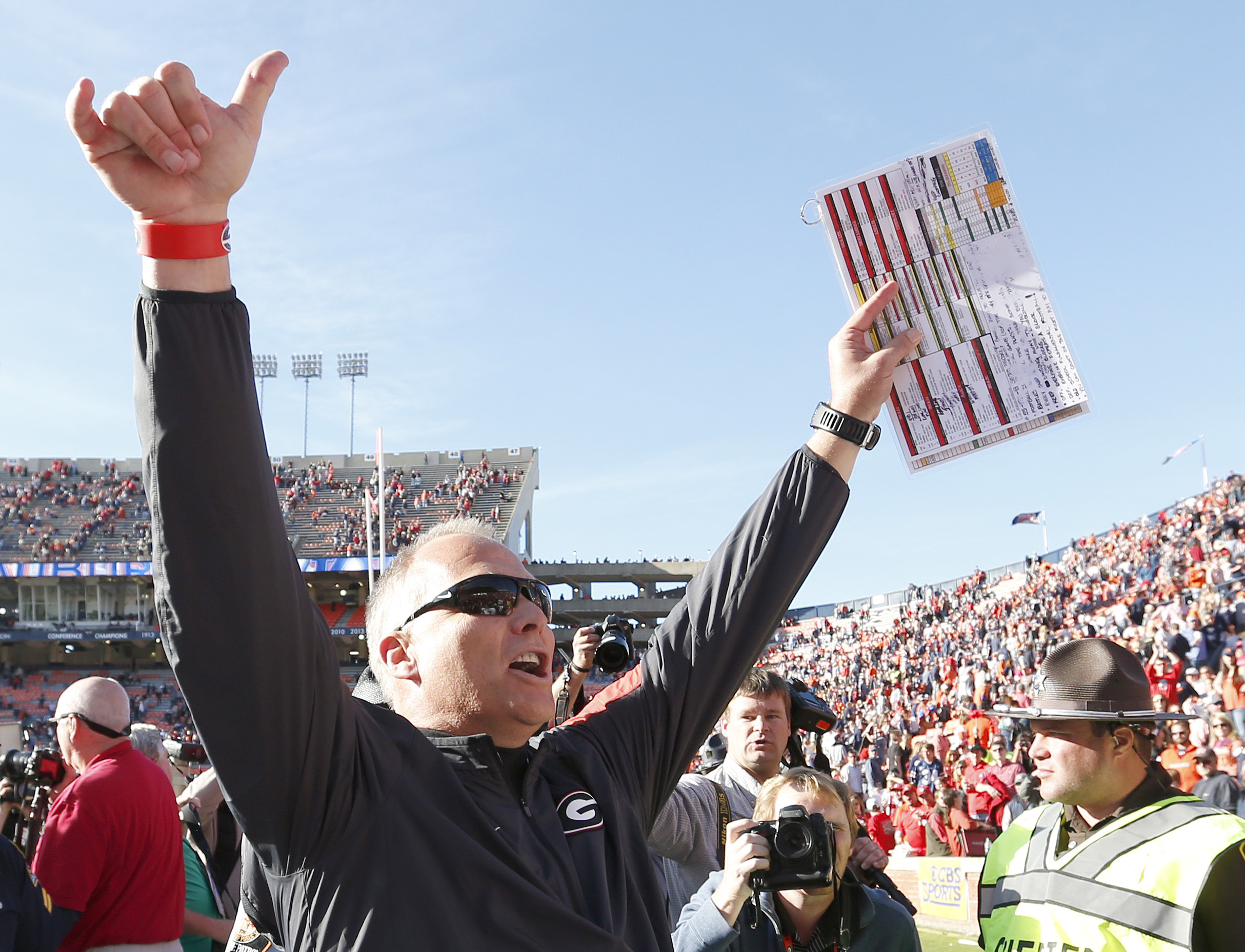 Georgia head coach Mark Richt celebrates as he walks off the field after they defeated Auburn 20-13 in an NCAA football game, Saturday, Nov. 14, 2015, in Auburn, Ala. (AP Photo/Butch Dill)