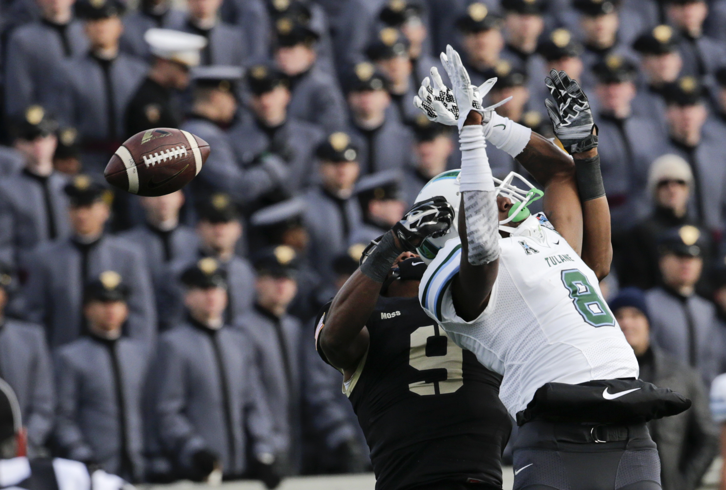 Army defensive back Xavier Moss (9) breaks up a pass intended for Tulane wide receiver Devon Breaux (8) during the second half of an NCAA college football game on Saturday, Nov. 14, 2015, in West Point, N.Y. Tulane won 34-31. (AP Photo/Mike Groll)