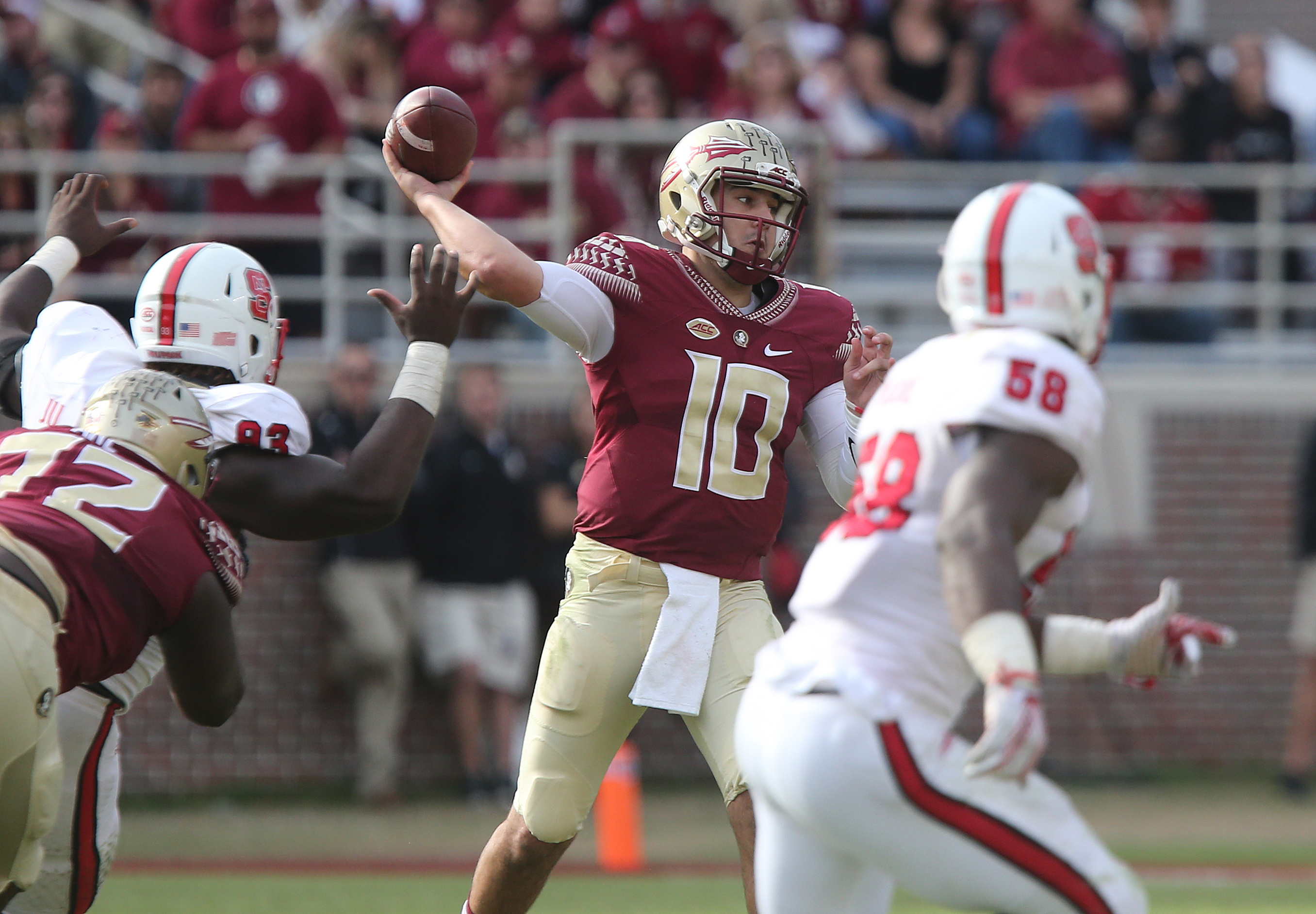 Florida State's Sean Maguire (10) attempts a pass against the North Carolina State defense in the second quarter of an NCAA college football game, Saturday, Nov. 14, 2015, in Tallahassee, Fla. (AP Photo/Steve Cannon)