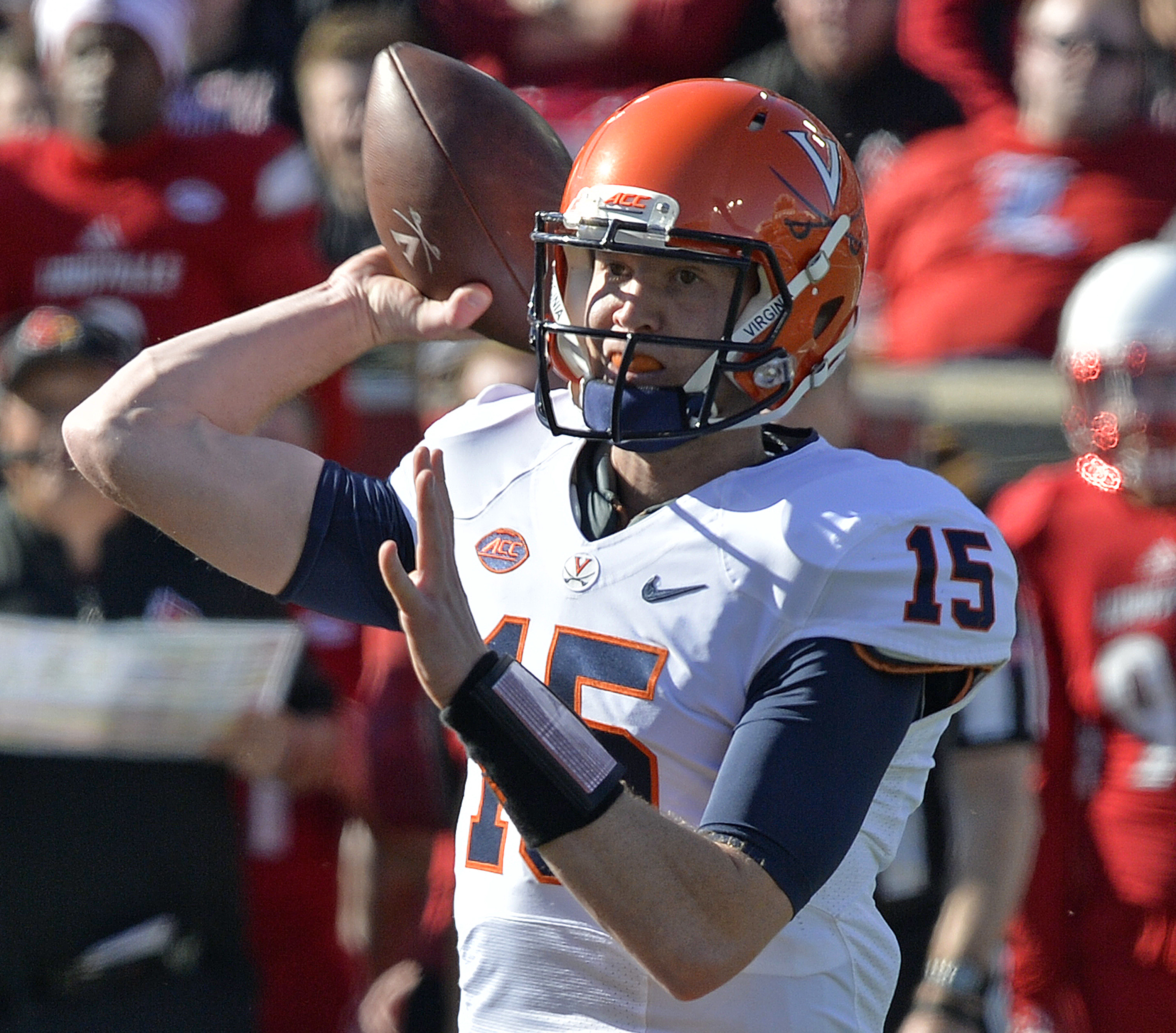 Virginia quarterback Matt Johns (15) throws to a receiver during the first half of an NCAA college football game against Louisville, Saturday, Nov. 14, 2015, in Louisville, Ky. Louisville won 38-31. (AP Photo/Timothy D. Easley)