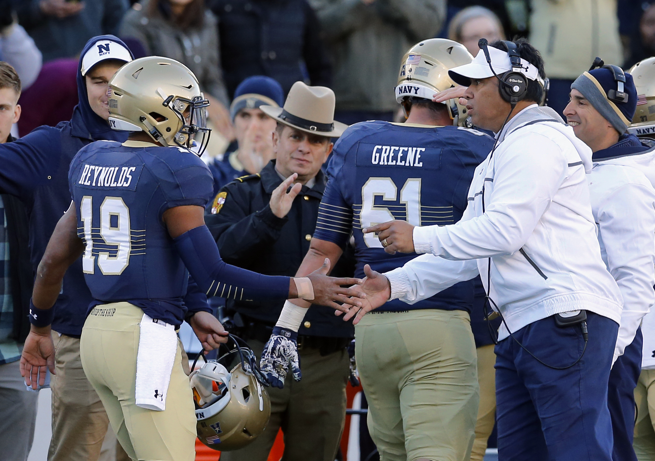 Navy head coach Ken Niumatalolo, right, greets quarterback Keenan Reynolds (19) after Reynolds scored a touchdown to break the NCAA all-time rushing touchdown record in the first half of an NCAA college football game against SMU, Saturday, Nov. 14, 2015,